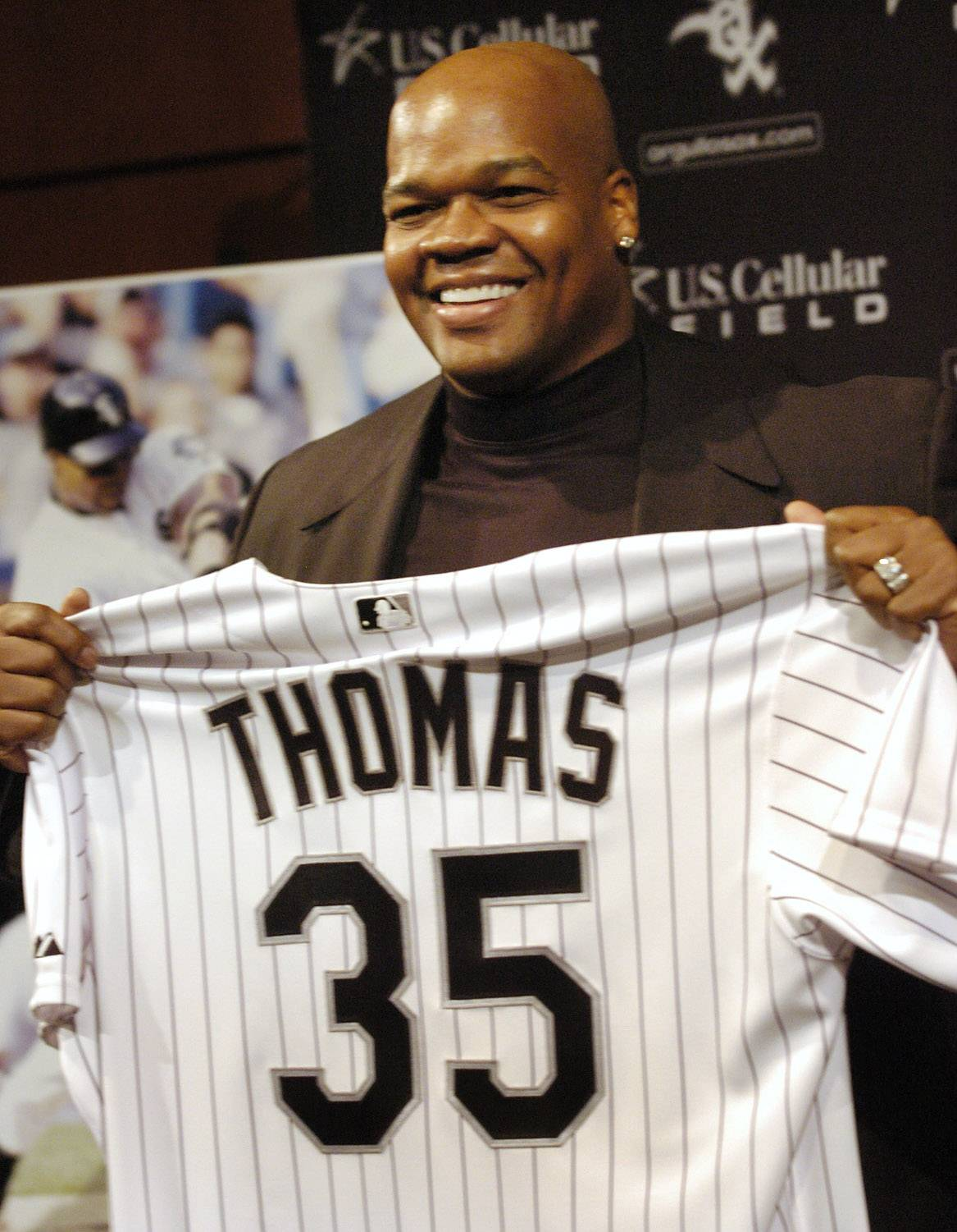 Frank Thomas holds up his soon to be retired jersey after announcing his retirement.