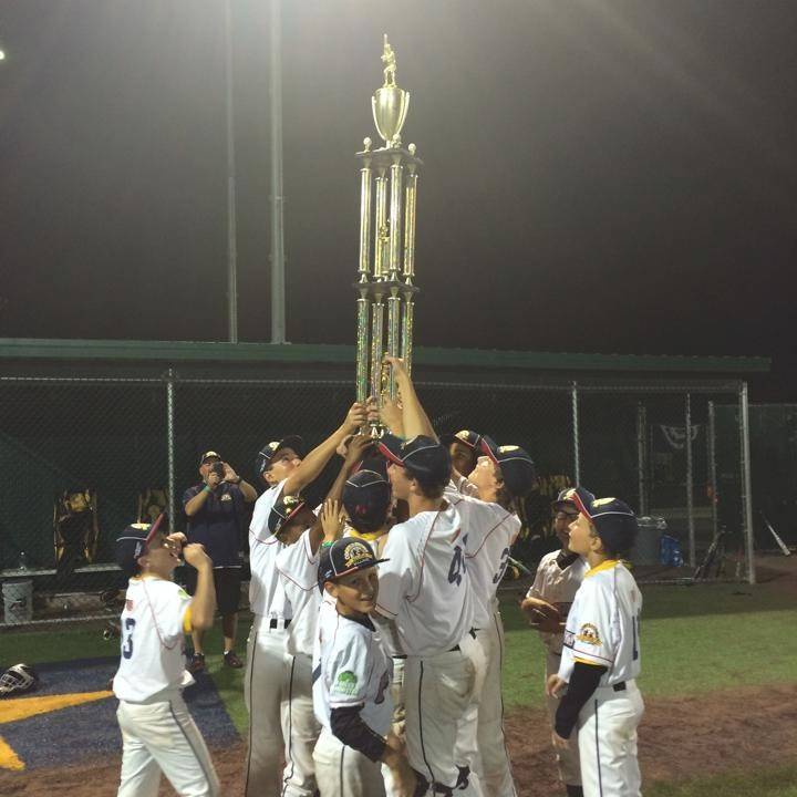 The Lake County Lightning hoist the trophy after becoming the first team from Lake County to win the Cooperstown All Star Village tournament.