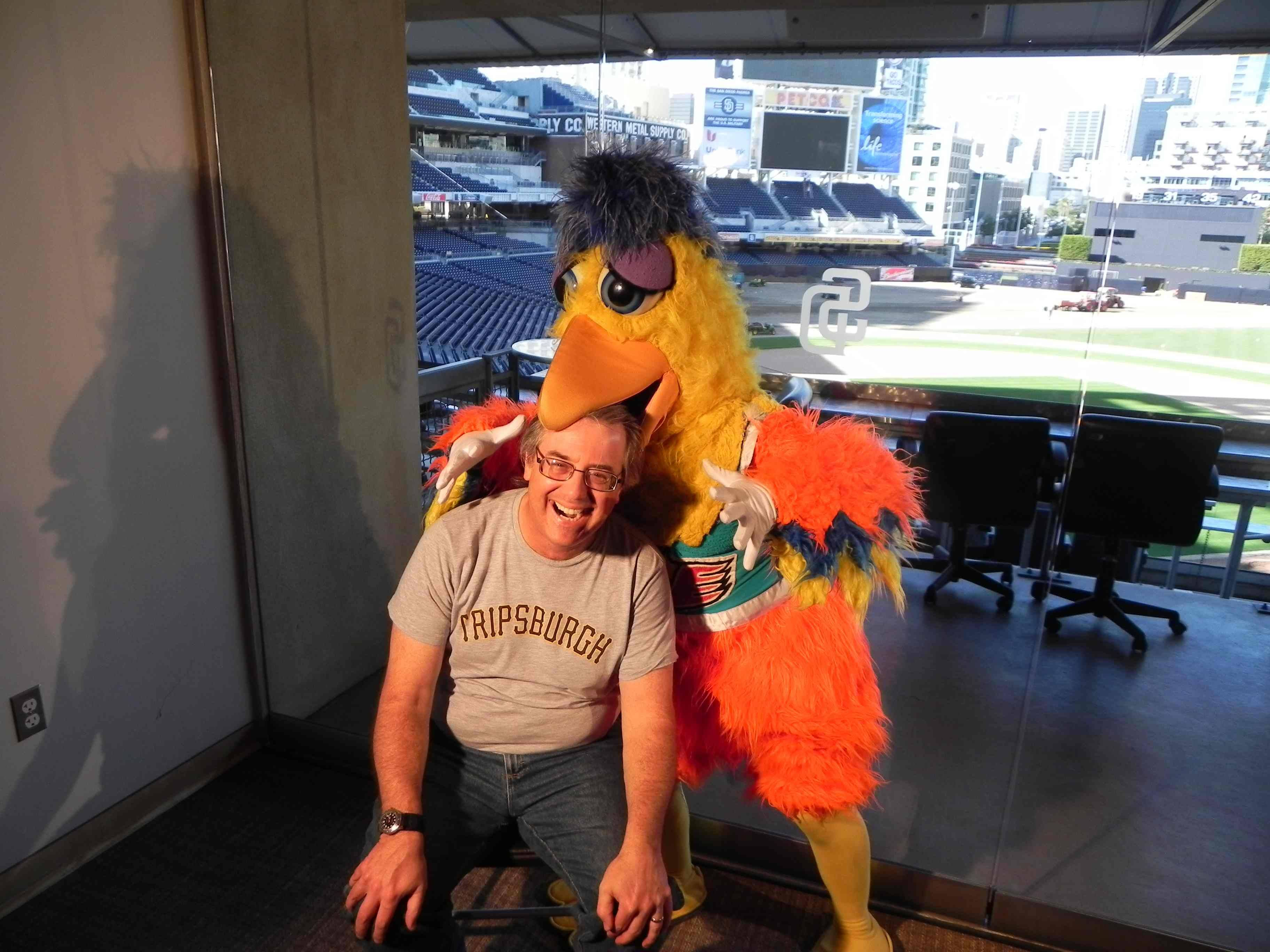 The world-famous San Diego Chicken takes a liking to producer/director Jon Leonoudakis during an interview at San Diego's Petco Park.Peter Padua
