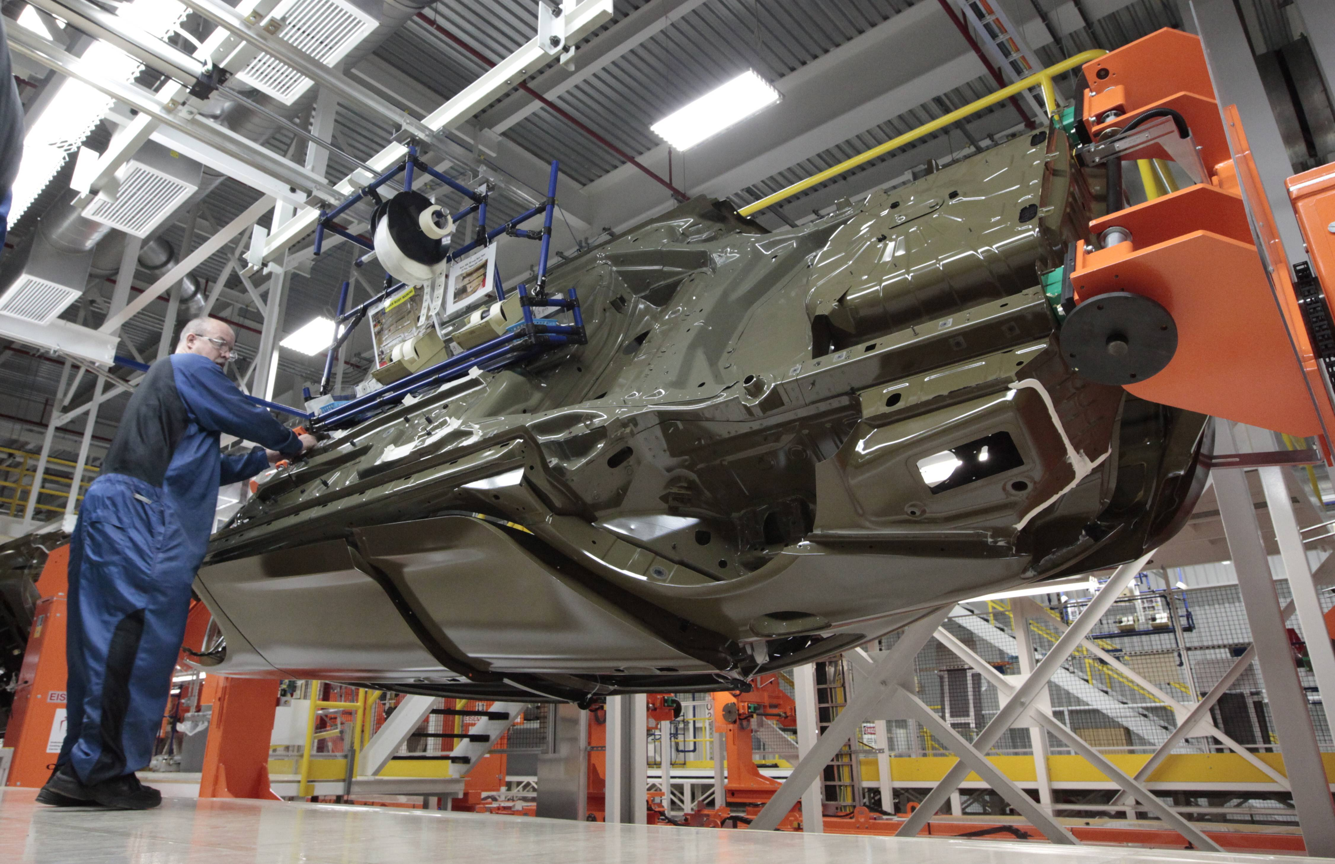 An assembly line worker works on a 2015 Chrysler 200 automobile at the Sterling Heights Assembly Plant in Sterling Heights, Mich.