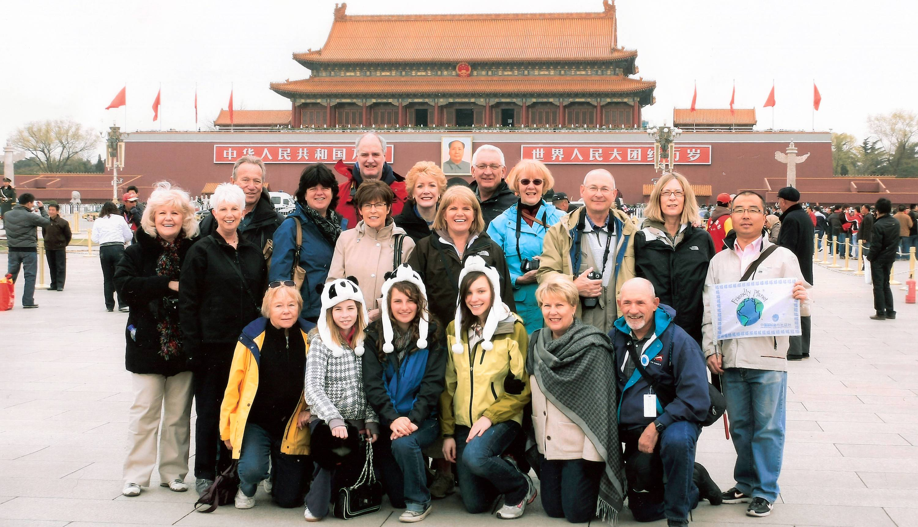 Participants on a Friendly Planet Travel group tour to China take a photo in Tiananmen Square in Beijing. There are many things to consider when choosing a group tour, including type of accommodations, activities and price. Friendly Planet offers a service to help solo travelers find compatible roommates and avoid the single supplement charge.