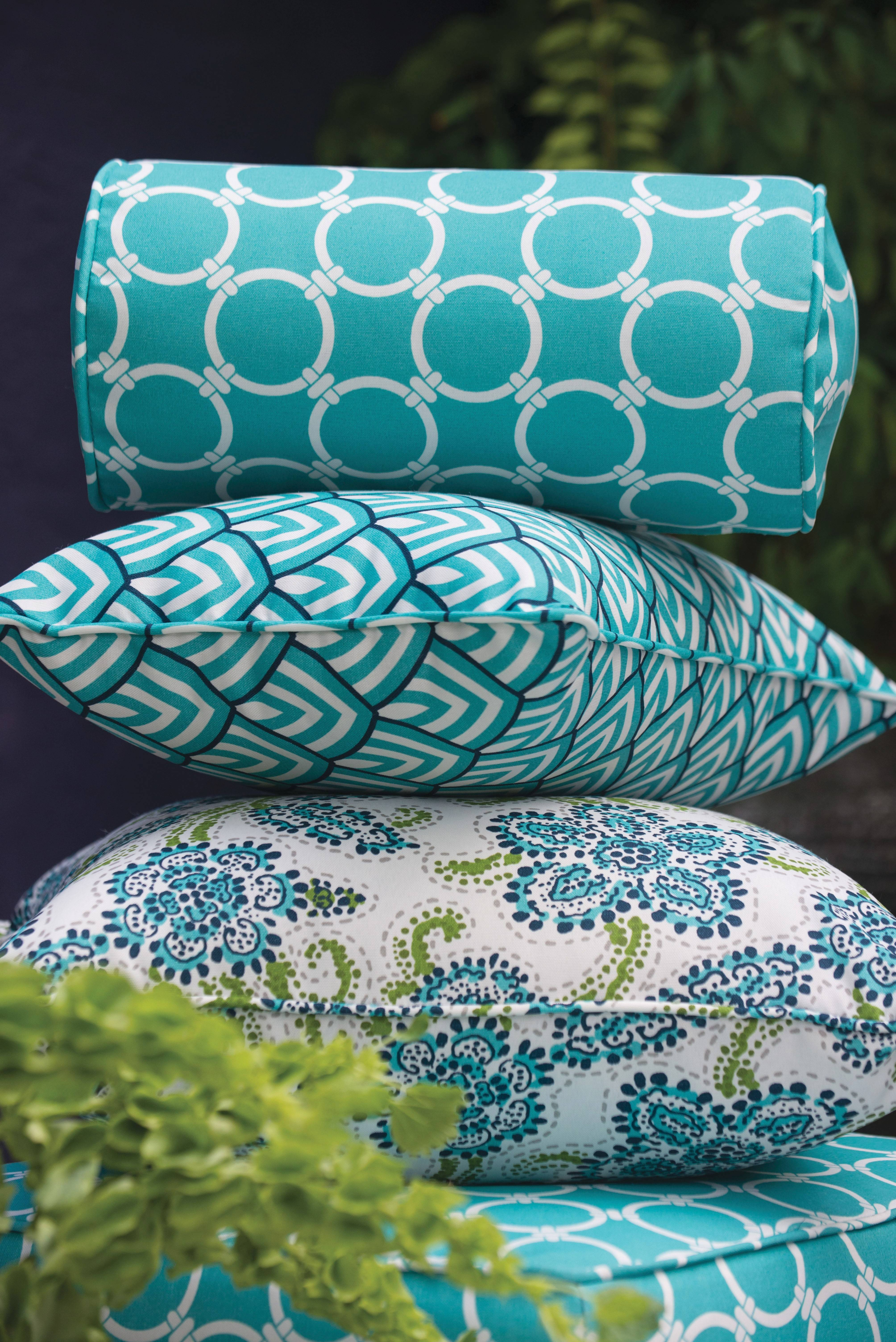 "Accessories like soft, richly textured pillows add ""warmth"" to an outdoor-living area, says designer Laurie Bell."