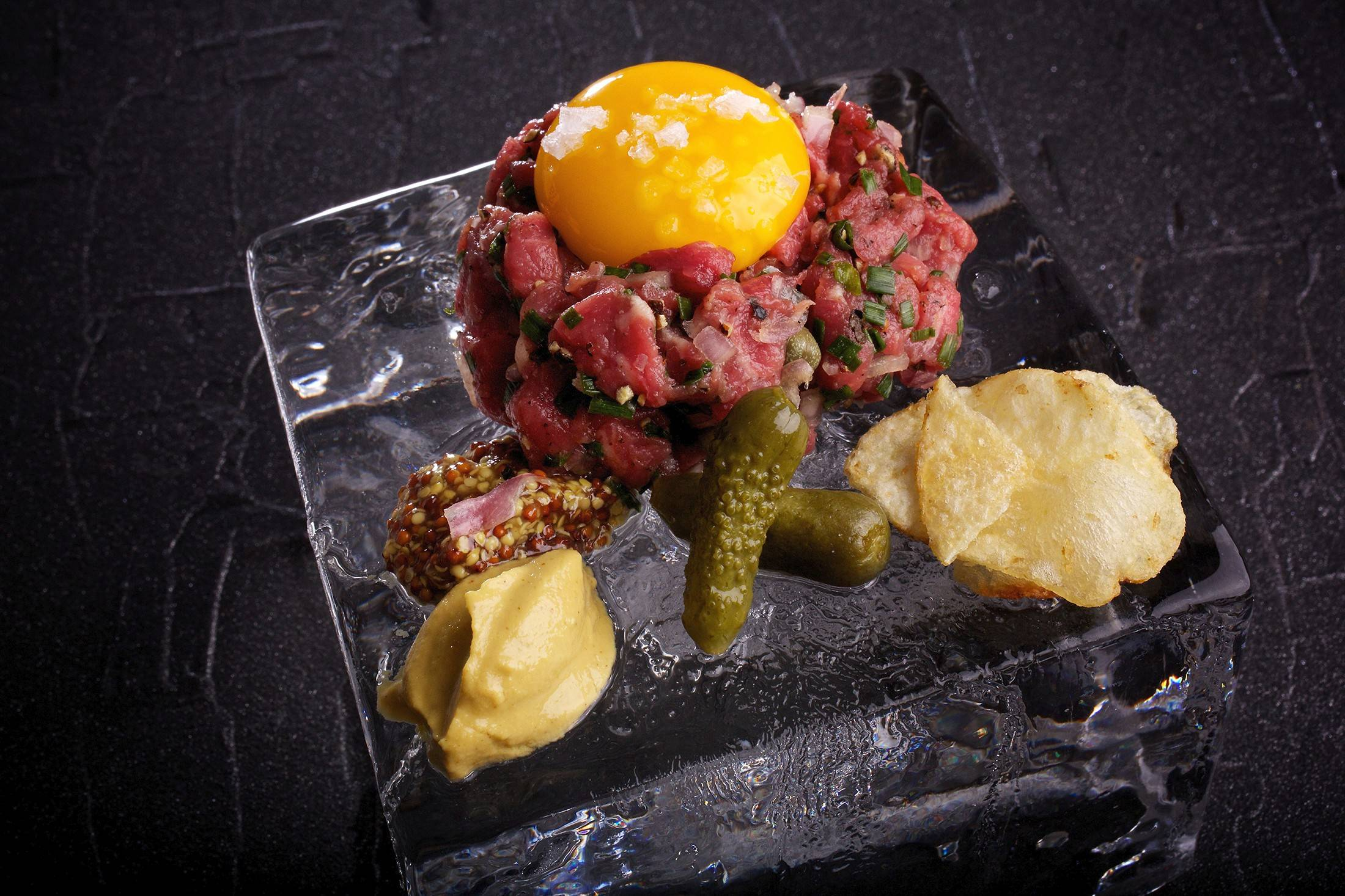 Hand-cut steak tartare plates are becoming less rare on fine-dining menus.