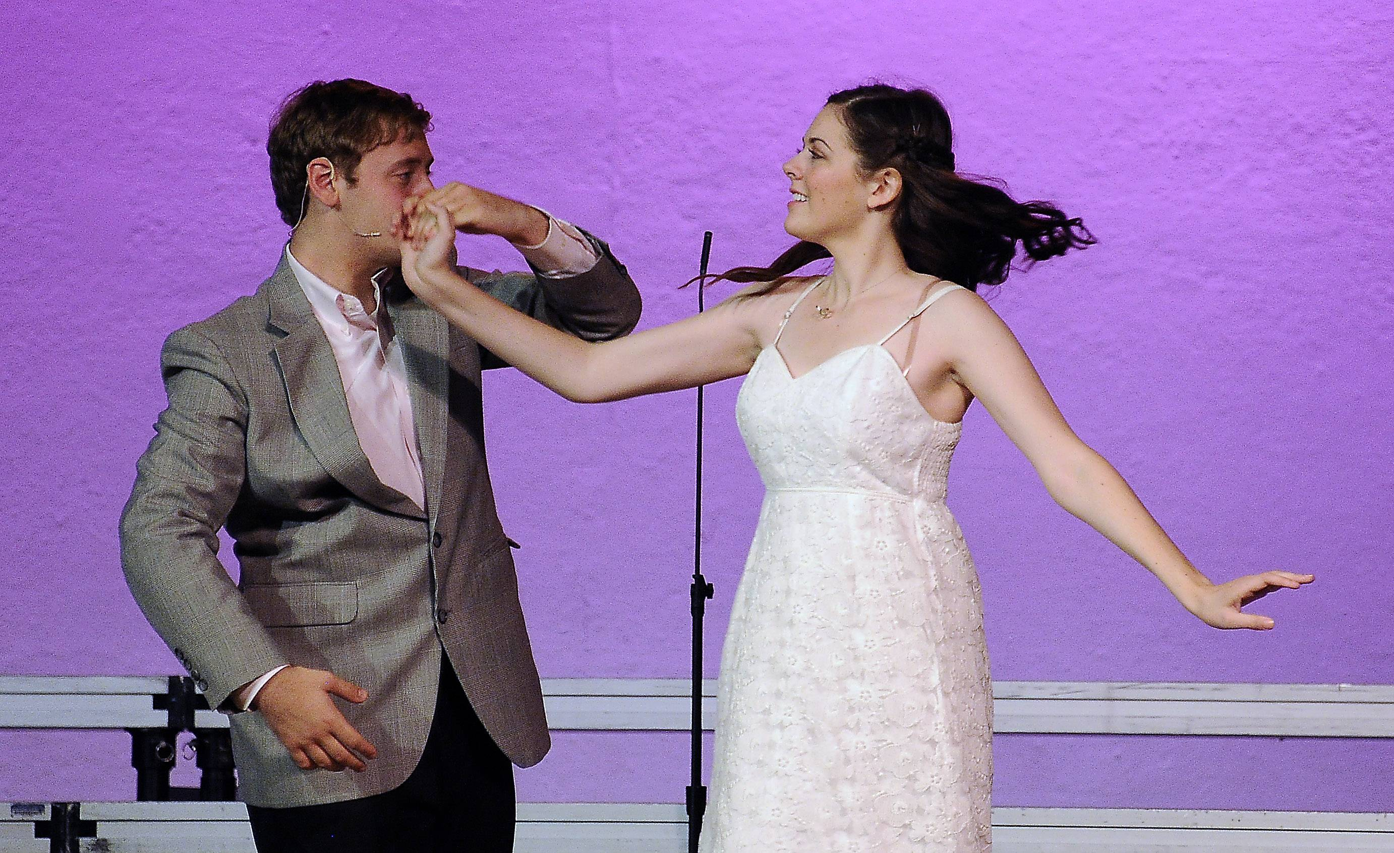 "Monica Tipperreiter, playing Lily, dances on stage with Haggai Simon, who plays Archibald Craven, during a special performance of the musical ""The Secret Garden"" Friday night at Mundelein High School. Monica, a senior, had been set to play the role this past spring, but she was unable to after she was diagnosed with a brain tumor."