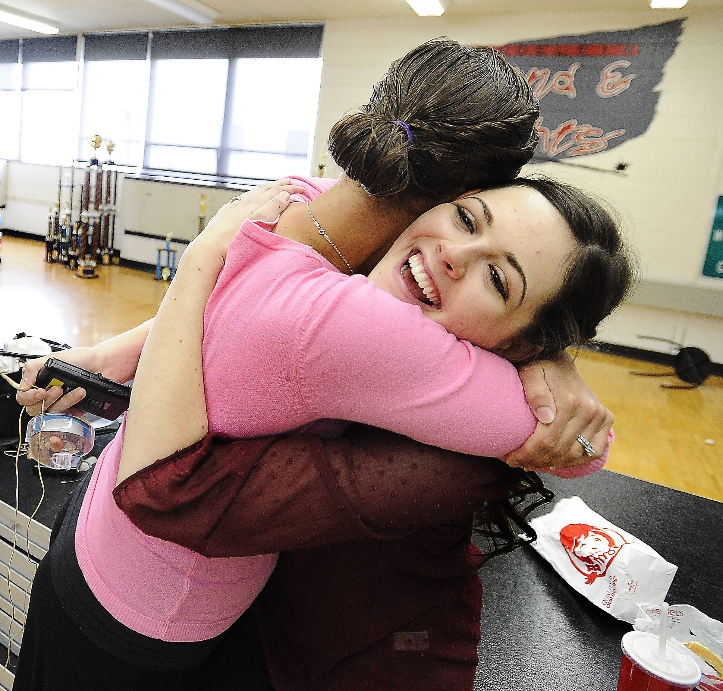 "Mundelein High School senior Monica Tipperreiter gets a hug from her vocal coach Cory Thompson before the musical ""The Secret Garden."" She played a ghost named Lily in the production, which had been Mundelein's musical this past spring. However, Monica was diagnosed with a brain tumor and had to miss the initial musical."