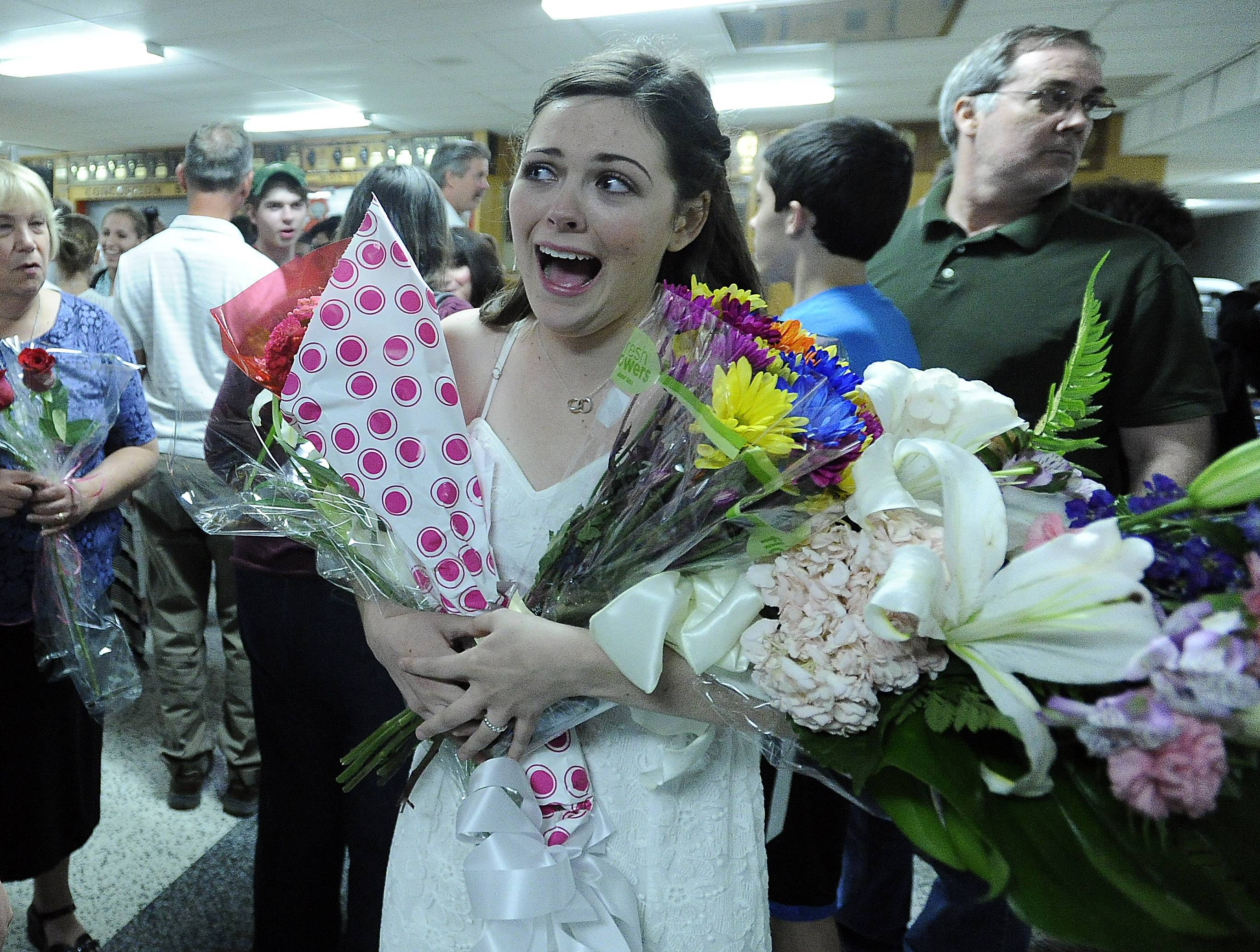 "Monica Tipperreiter, who played Lily in ""The Secret Garden,"" was showed with flowers by friends and family after her performance Friday night at Mundelein High School."