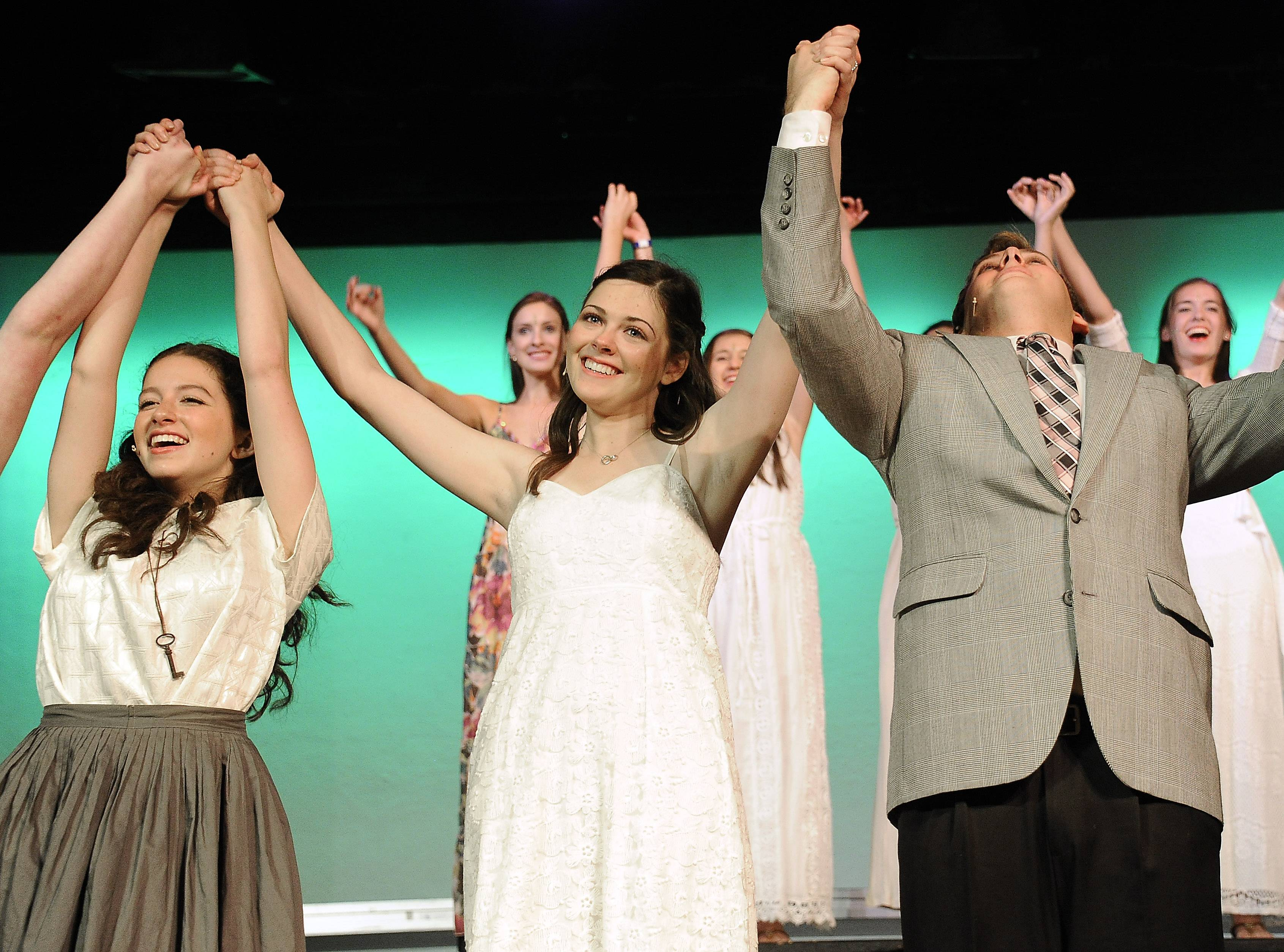 "Monica Tipperreiter, center, takes a bow with her fellow actors after starring in the musical ""The Secret Garden"" Friday night at Mundelein High School."
