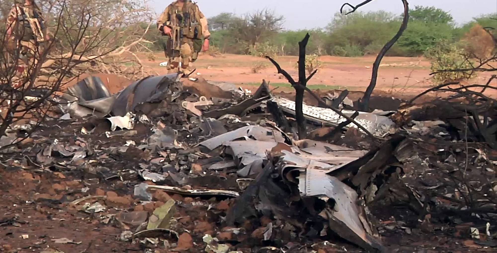 French soldiers secured a black box from the Air Algerie wreckage site in a desolate region of restive northern Mali on Friday, the French president said. Terrorism hasn't been ruled out as a cause, although officials say the most likely reason for the catastrophe that killed all onboard is bad weather. At least 116 people were killed in Thursday's disaster, nearly half of whom were French.