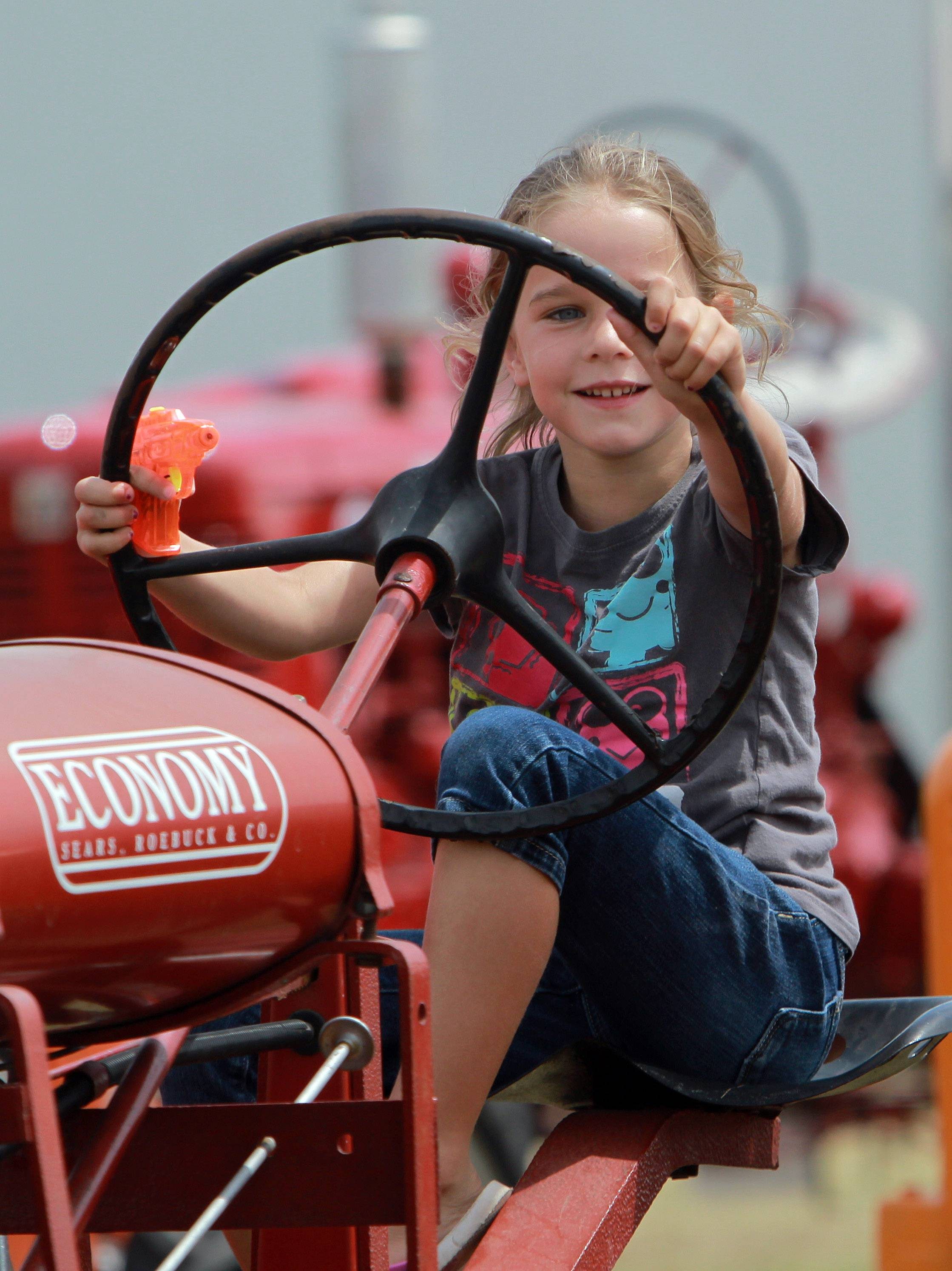 Six-year-old Addison Kane of Grayslake sits in a tractor.