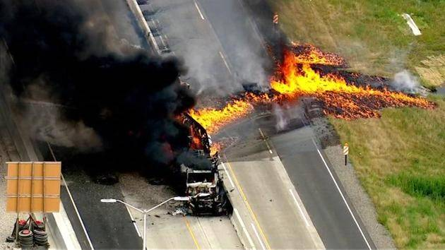 A semitrailer truck fire on the Jane Addams Tollway near Huntley spread to the grass, halting traffic in both directions.