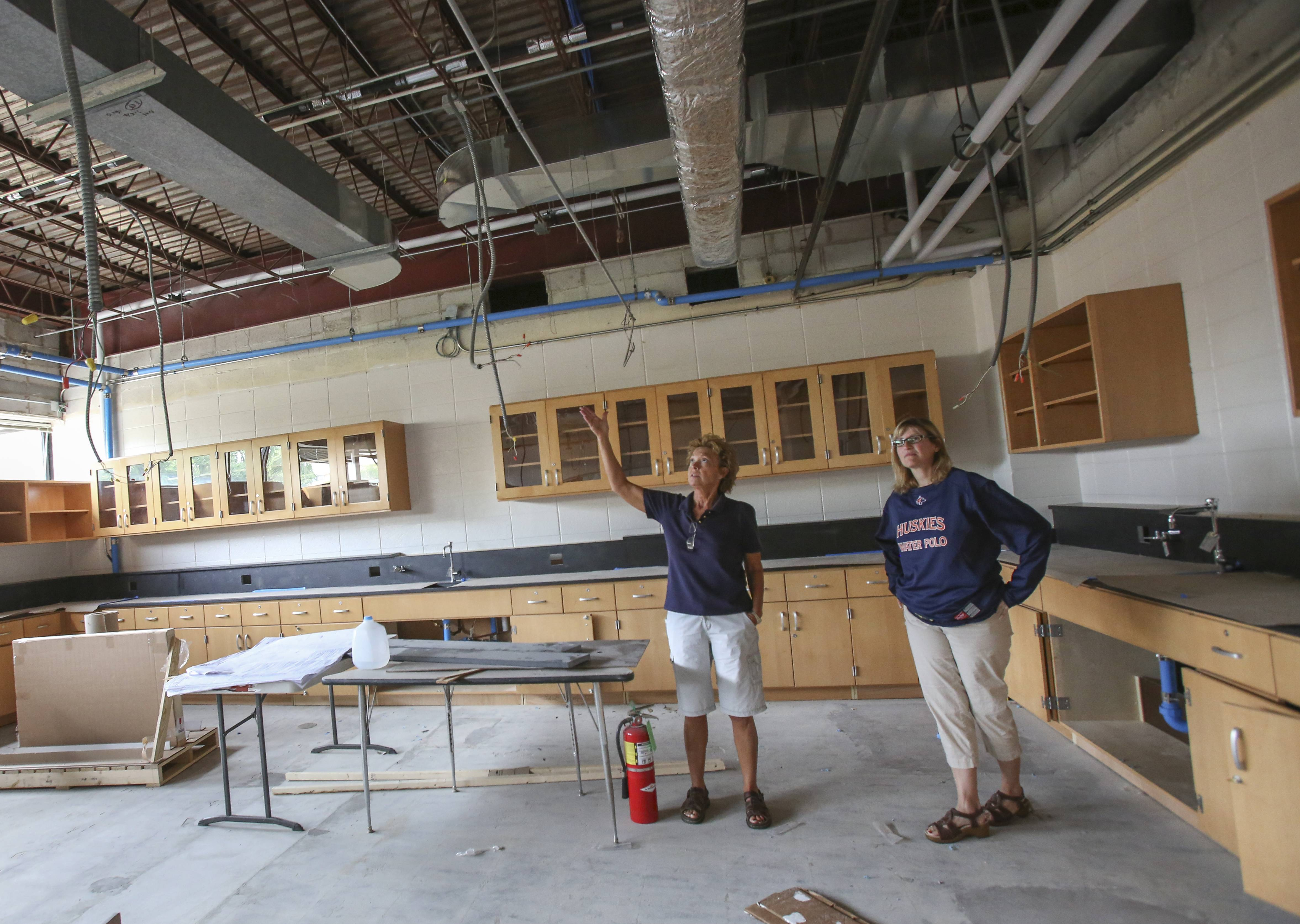 Lisa Corrigan, facility manager, and Michele Chapman, assistant principal for curriculum and instruction, take a look at a new science classroom taking shape at Naperville North High School.