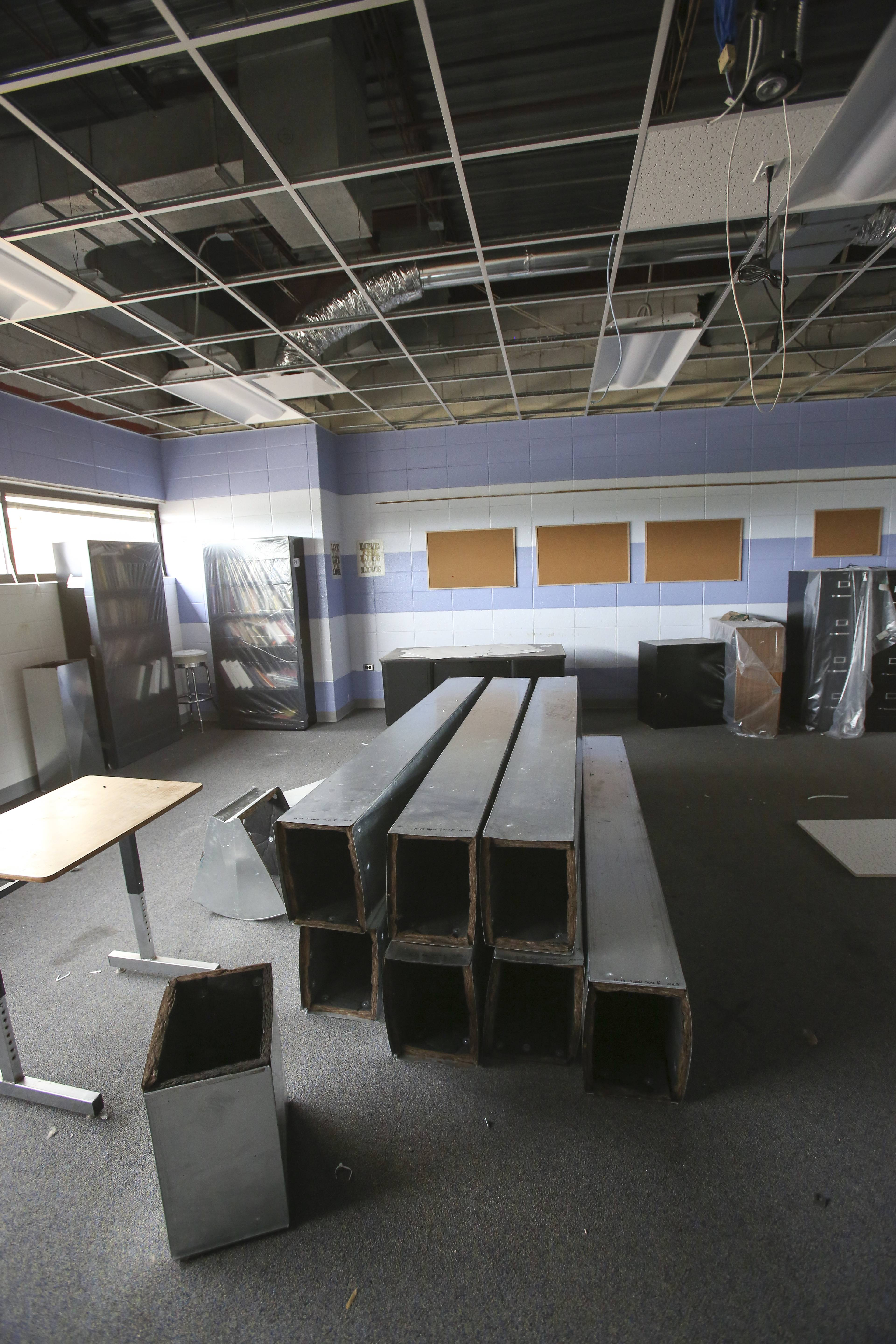 Old ducts sit in a classroom as they are replaced as part of ongoing construction at Naperville North High School.