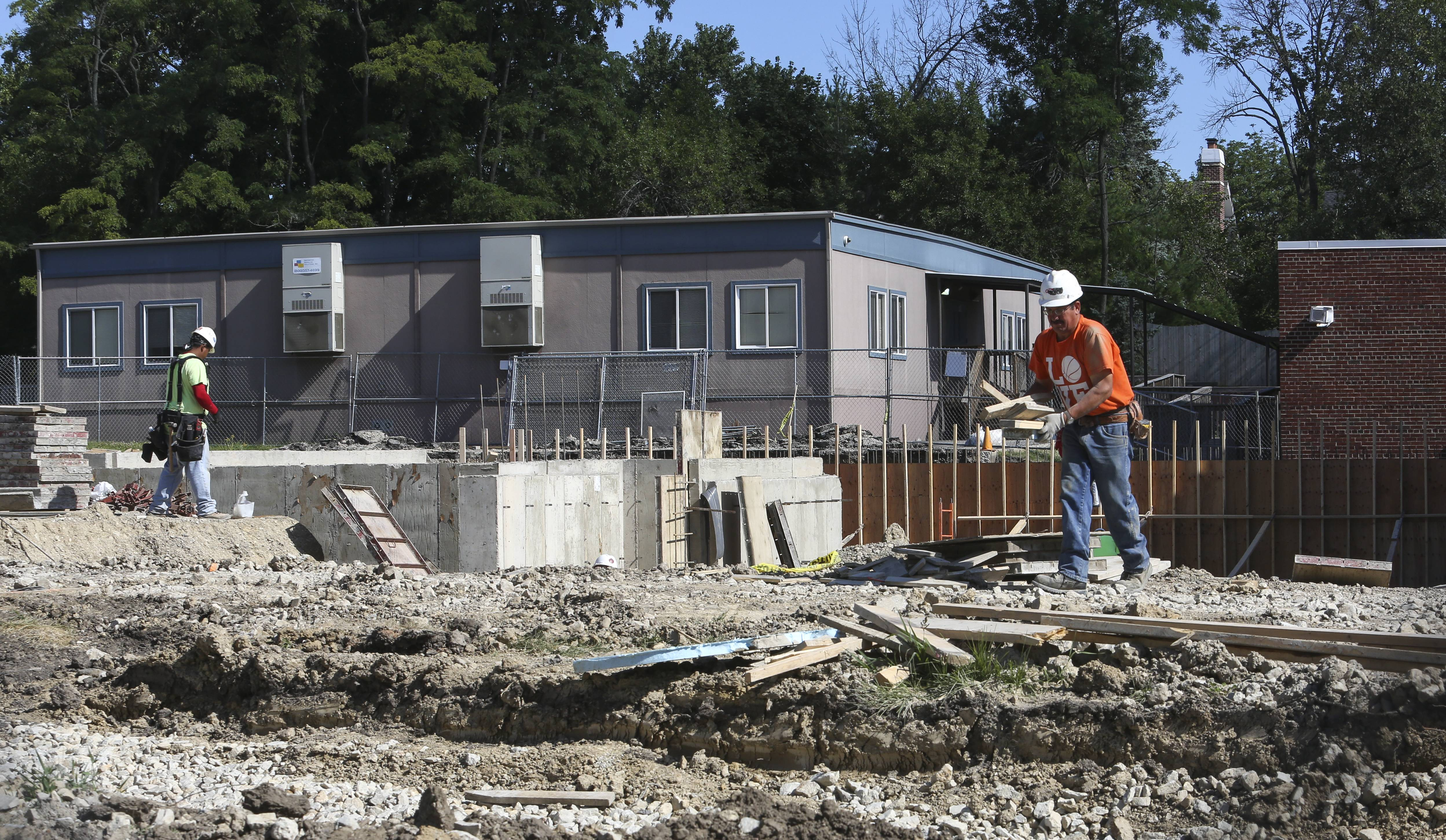 Construction crews work Thursday on a building addition at Franklin Elementary School in Glen Ellyn District 41. Franklin is one of four district schools that will get new classrooms as part of a two-year, $15 million project.