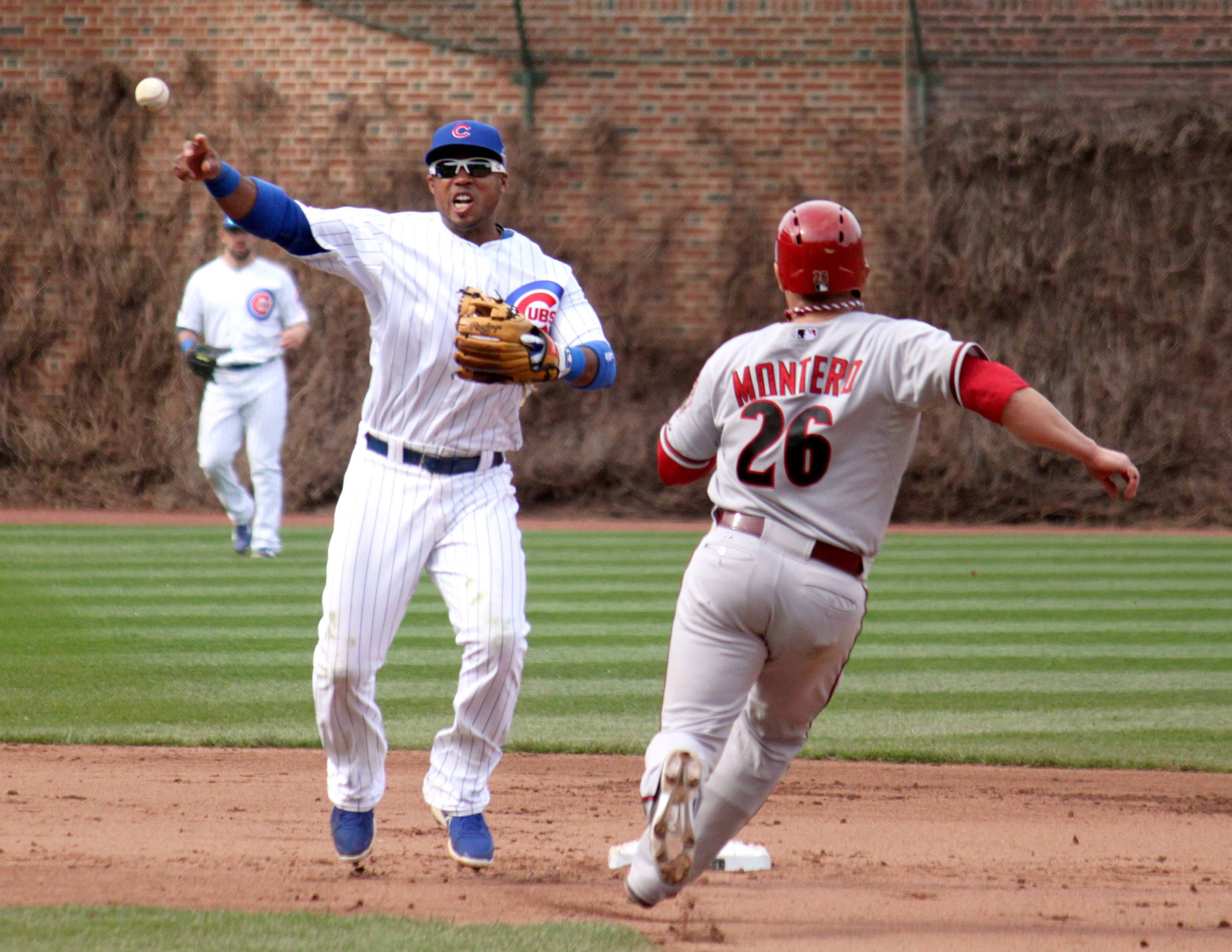 Chicago Cubs player Luis Valbuena completes a double play against the Arizona Diamondbacks at Wrigley Field on April 24.