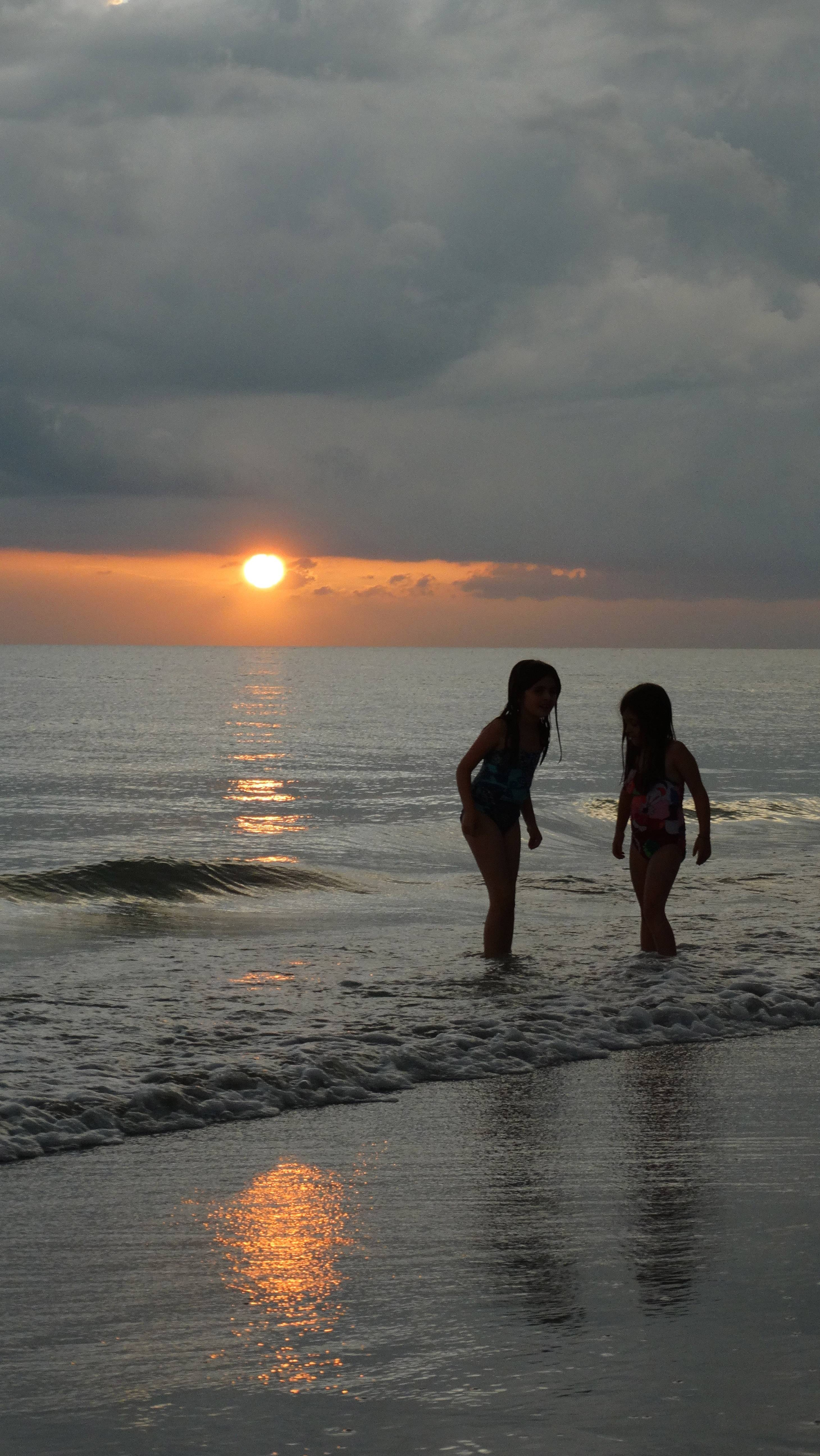 Watching my granddaughters (Sophia and Bailey ... ages 8 and 6) and the Sunset while on vacation in Florida with my daughter and her family who live in Kennesaw, Georgia.Photo was taken at Redington Beach, Florida.