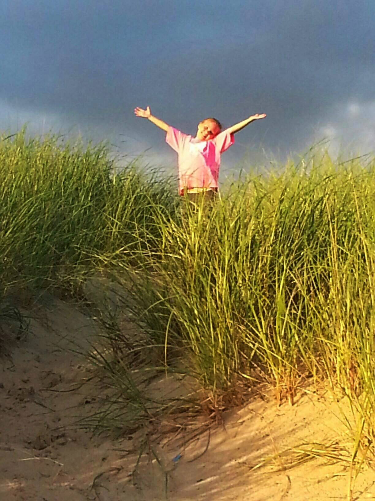 Gracie plays on the dunes earlier this month at New Buffalo Beach in Michigan.