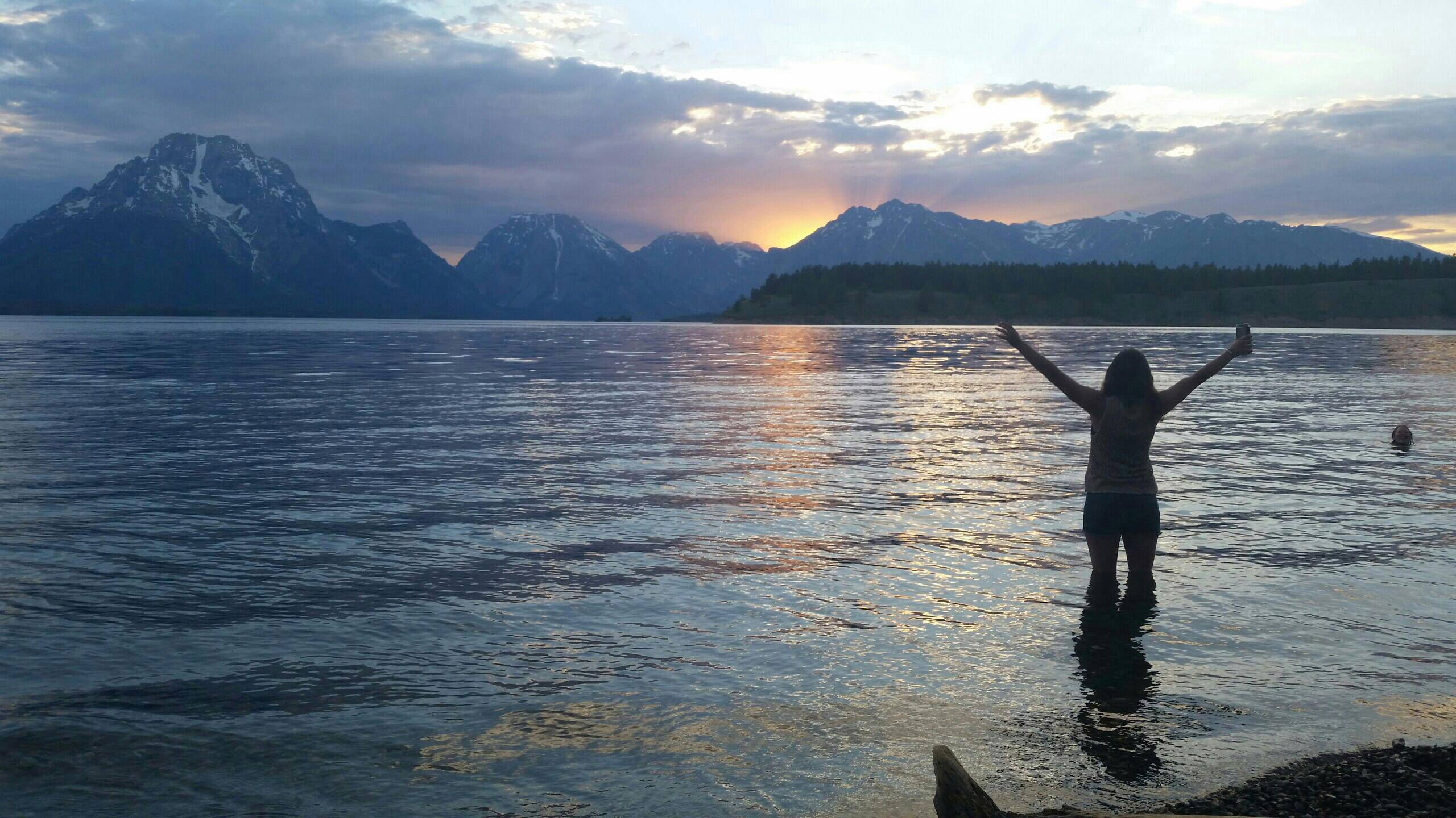 Kayla Smith takes in the sunset after swimming in Jackson Lake in Tetons National Park in Wyoming.