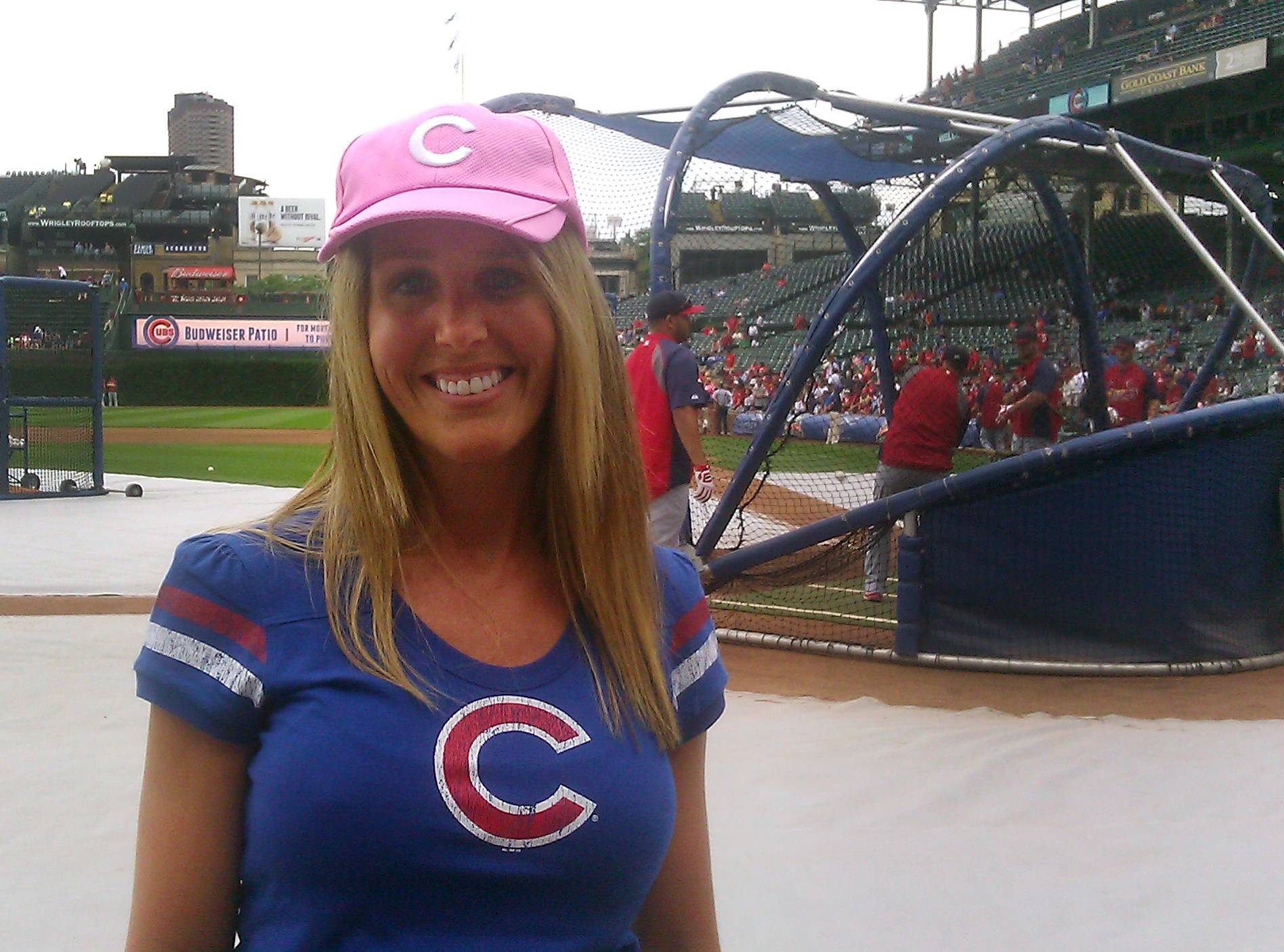 Aimee Suyko, a breast cancer survivor from Cary, enjoys time on Wrigley Field Friday. Suyko threw out a ceremonial first pitch before the Cubs' game against the St. Louis Cardinals.