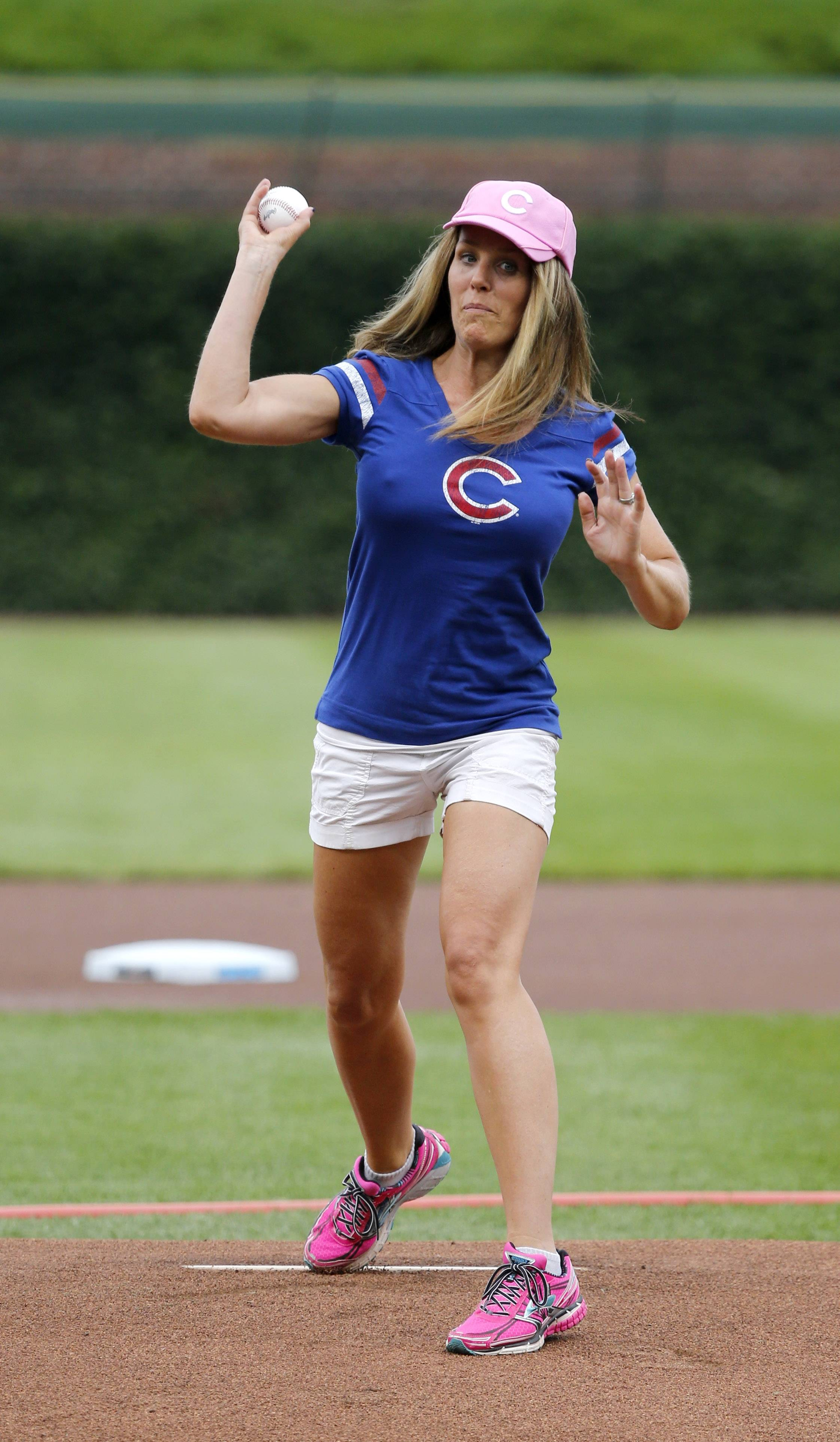 Aimee Suyko throws out a ceremonial first pitch before the Cubs played St. Louis at Wrigley Field on Friday.