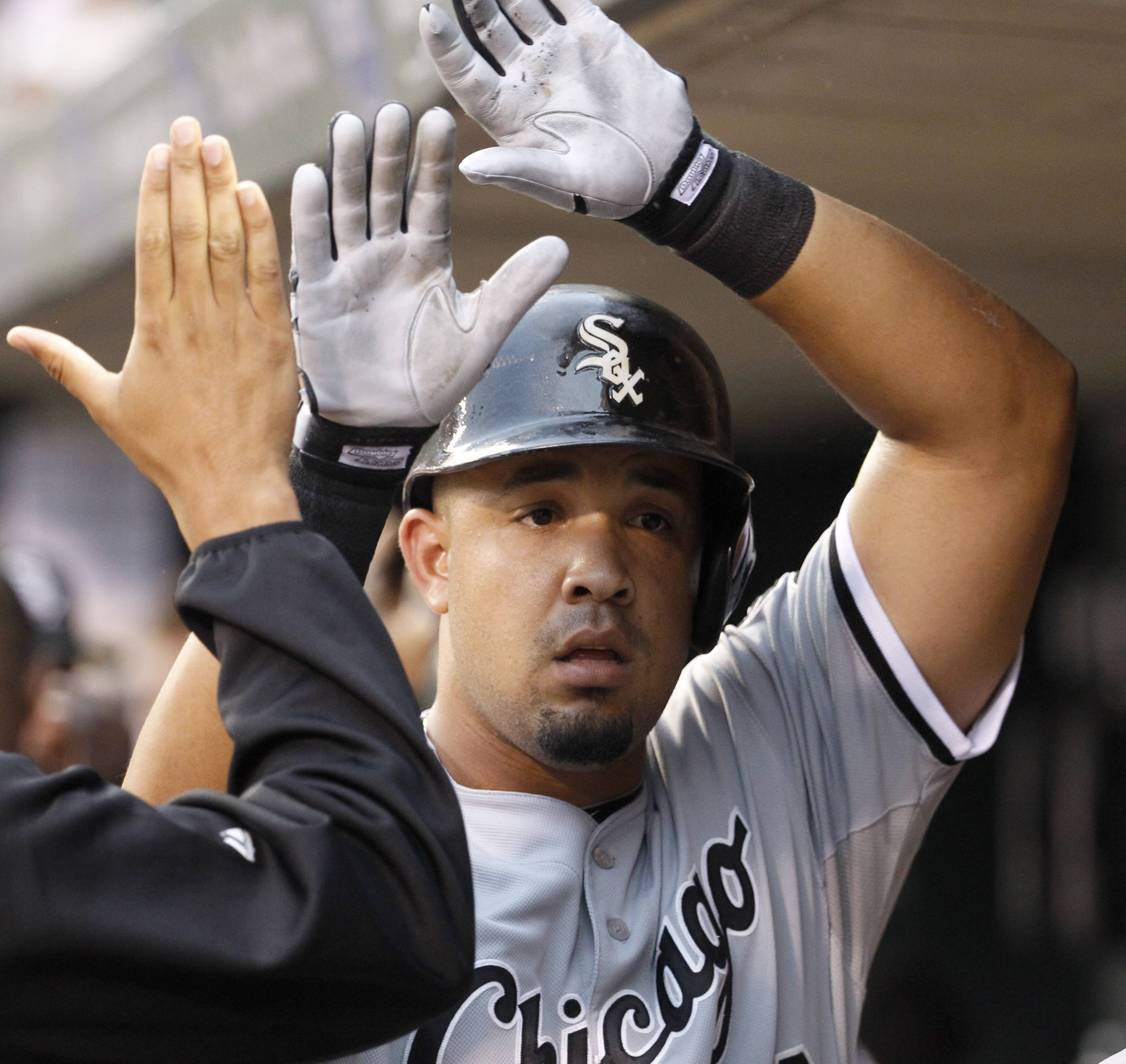 White Sox's Jose Abreu is congratulated in the dugout after his three-run home run off Minnesota Twins starting pitcher Kevin Correia during the first inning of a baseball game in Minneapolis, Friday.