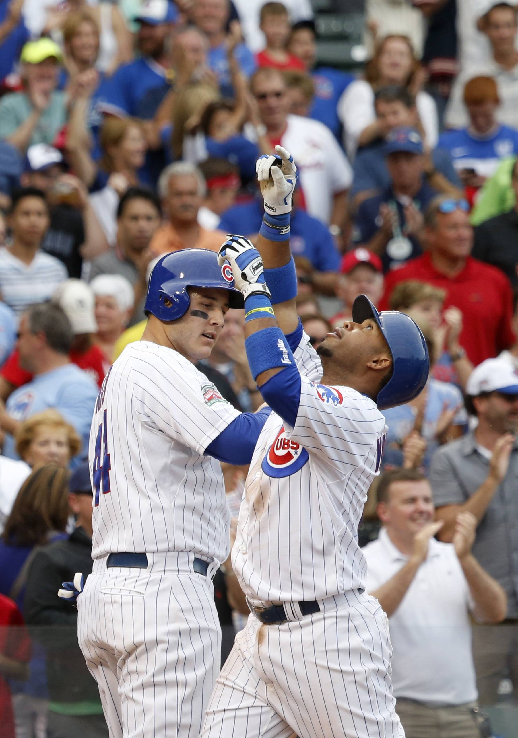 Luis Valbuena, right, celebrates his home run off Cardinals relief pitcher Kevin Siegrist during the seventh inning of the Cubs' victory over St. Louis on Friday.