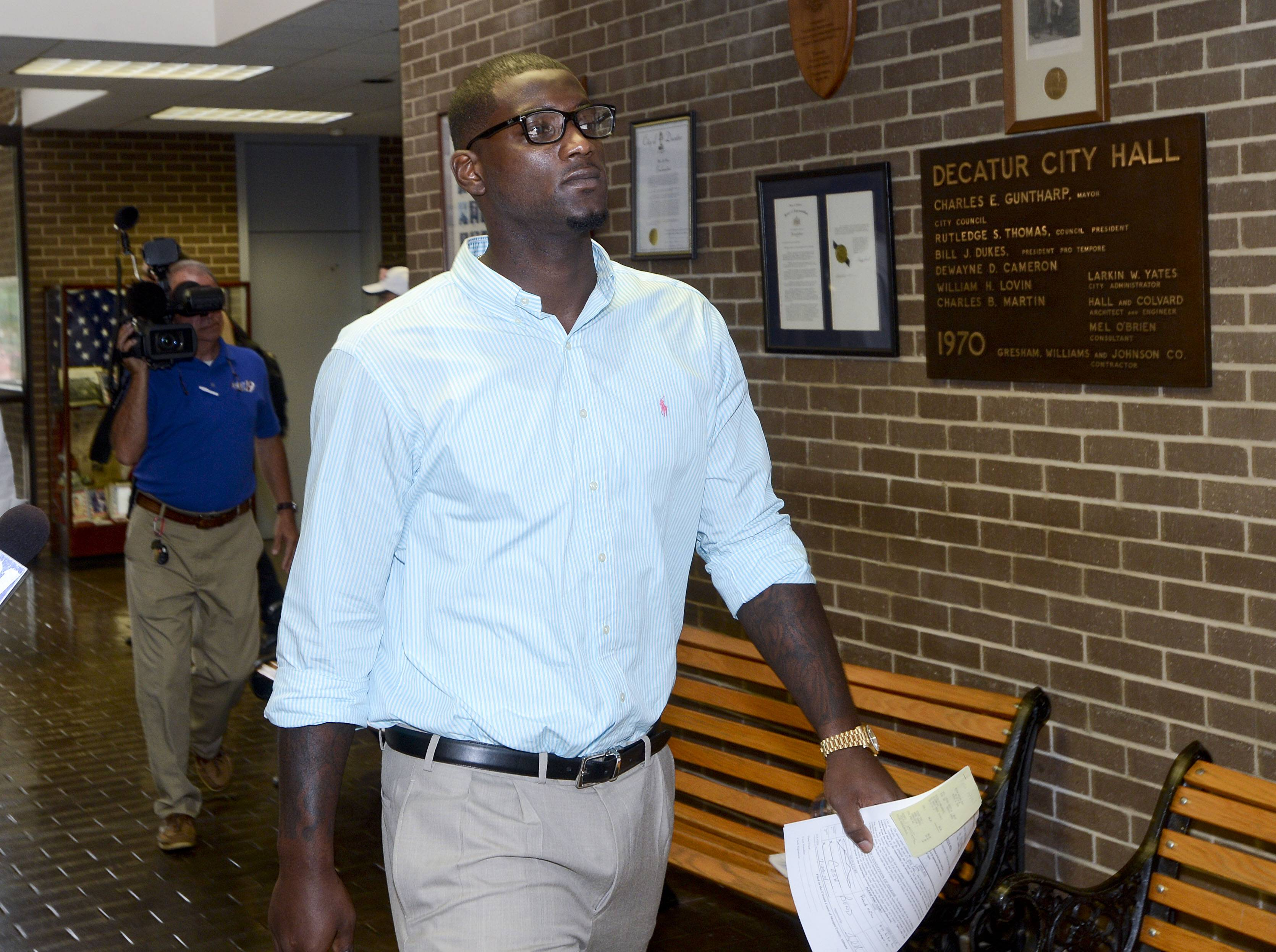 Dallas Cowboys linebacker Rolando McClain leaves court in Decatur, Ala., Friday, July 25, 2014. McClain was convicted of resisting arrest and disorderly conduct..