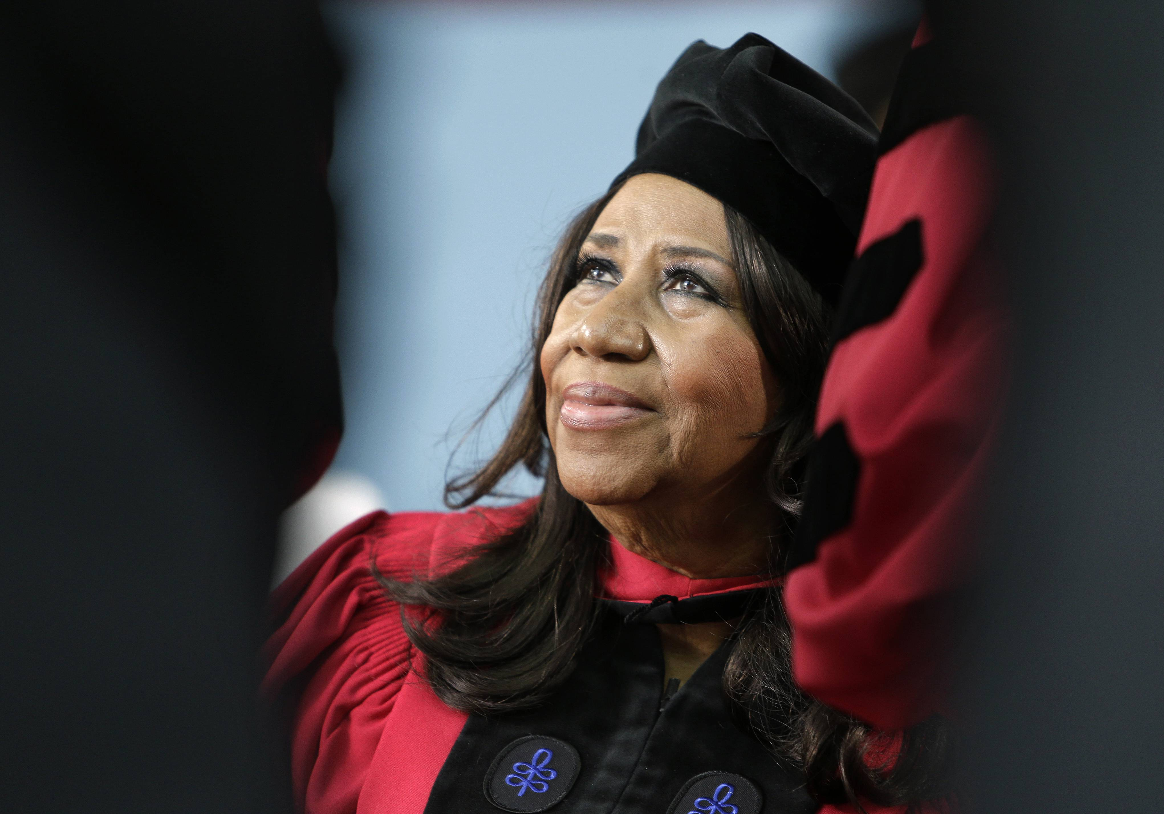 "In this May 29 file photo, singer Aretha Franklin looks up while seated onstage during Harvard University commencement ceremonies, in Cambridge, Mass., where she was presented with an honorary Doctor of Arts degree. Franklin has some harsh words for a New York server at a Johnny Rockets restaurant in Lewiston near Buffalo who told the Queen of Soul she wasn't allowed to eat her takeout inside the restaurant. A spokesman for Franklin says on Tuesday, July 22, Franklin ordered a hamburger after performing a sold-out show. But he says the server screamed at Franklin, saying she couldn't sit down to eat because she had ordered takeout. A Johnny Rockets spokeswoman says the franchise owner is sorry for the actions of ""a new and very young employee."""