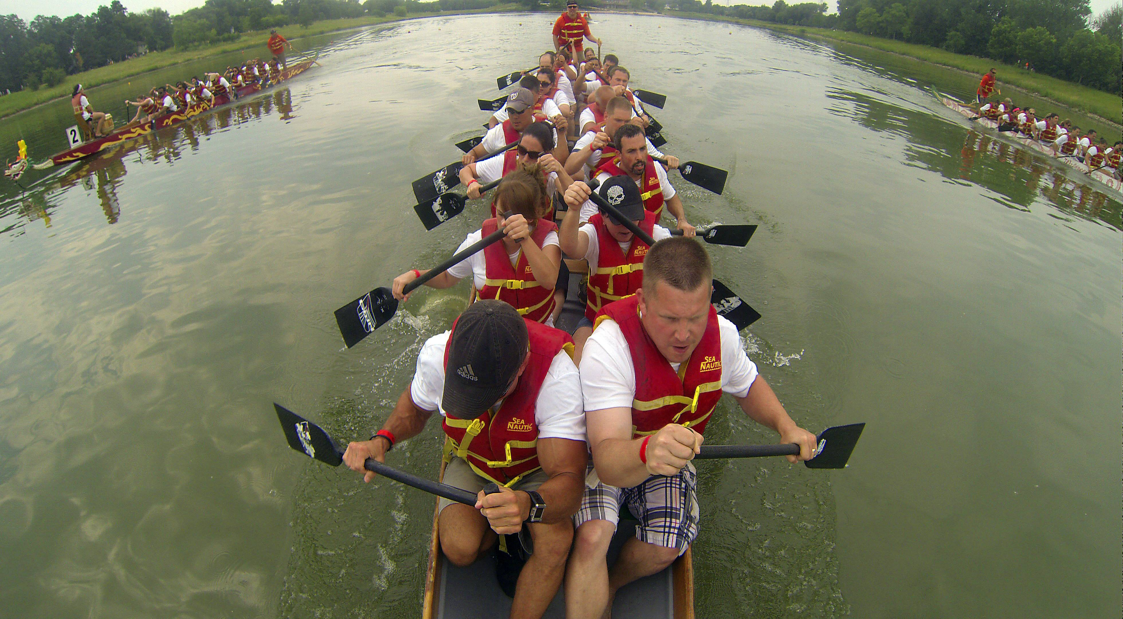 The Walgreens Dragon Boat team Pharma-Seas outrows other teams for a victory Saturday at the Walgreens Chicago International Dragon Boat Festival at Lake Arlington.