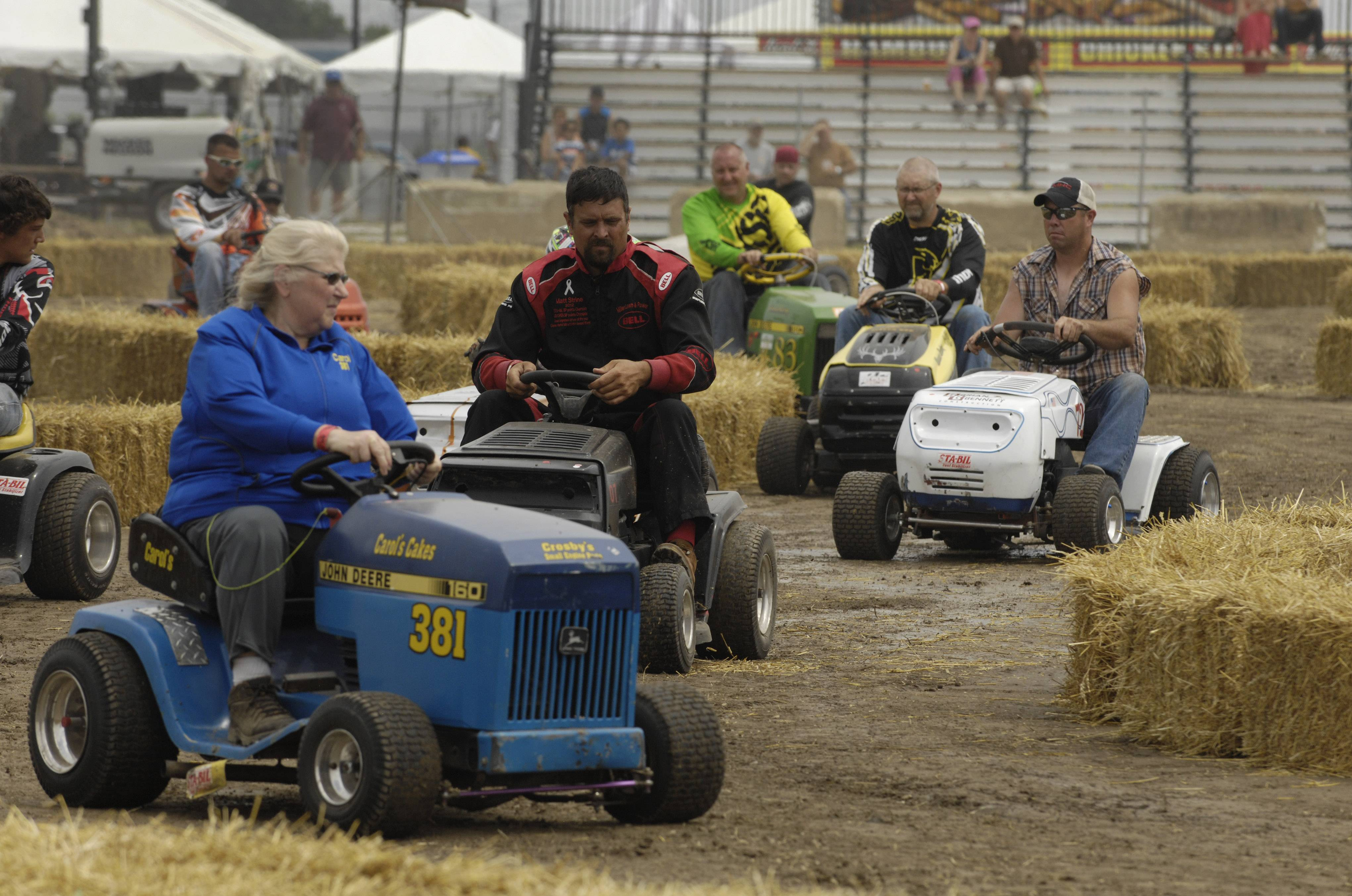 "Competitors from 10 states participate in the pre-race parade Saturday during the ""Mow Down Showdown"" lawn mower races at Lake County Fair in Grayslake."