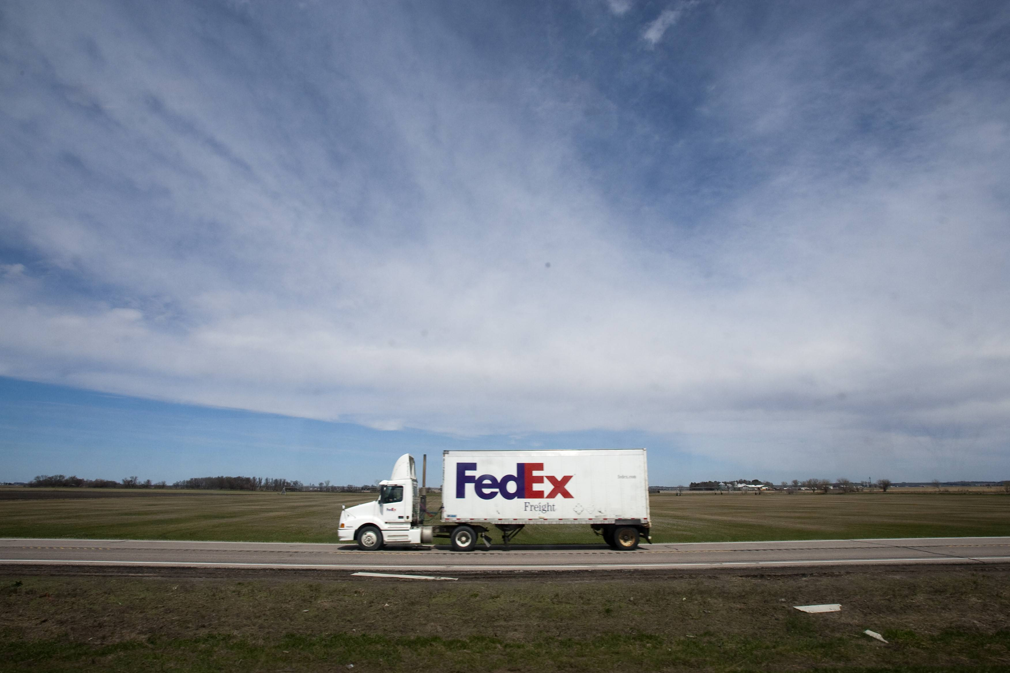 This April 7, 2010 file photo shows a Federal Express delivery truck traveling north of Fremont, Neb. FedEx Corp. is under criminal indictment and facing $1.6 billion in penalties on allegations the company failed to police the activities of illegal online pharmacies that use the shipping service to deliver prescription drugs.