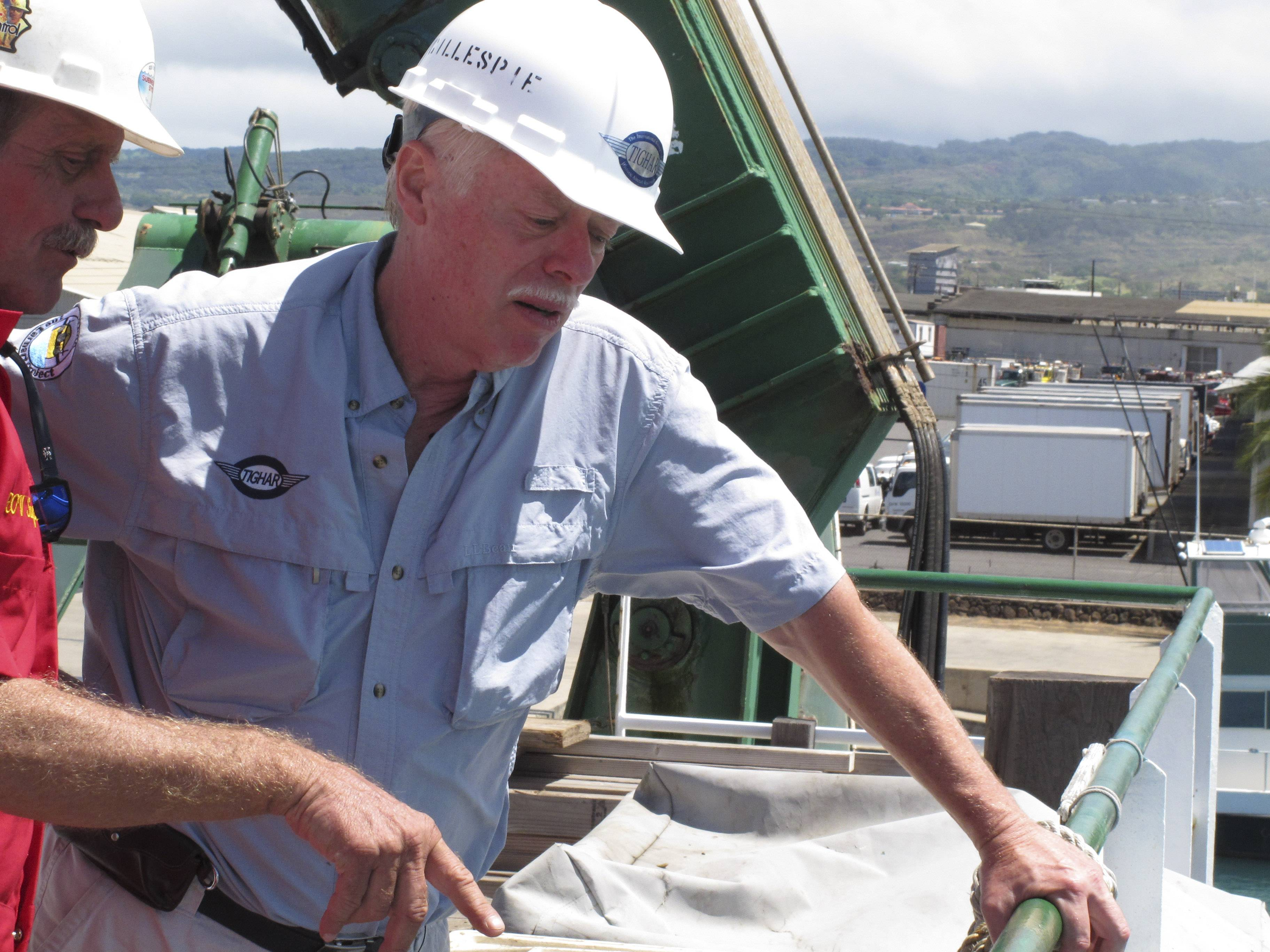 In 2012 Ric Gillespie, right, founder of The International Group for Historic Aircraft Recovery, watches equipment testing alongside Wolfgang Burnside from aboard a ship at port in Honolulu. A federal judge has dismissed a Wyoming man's lawsuit claiming a group secretly found the missing airplane of aviation pioneer Amelia Earhart in the South Pacific but kept it quiet so it could continue to raise funds for the search.