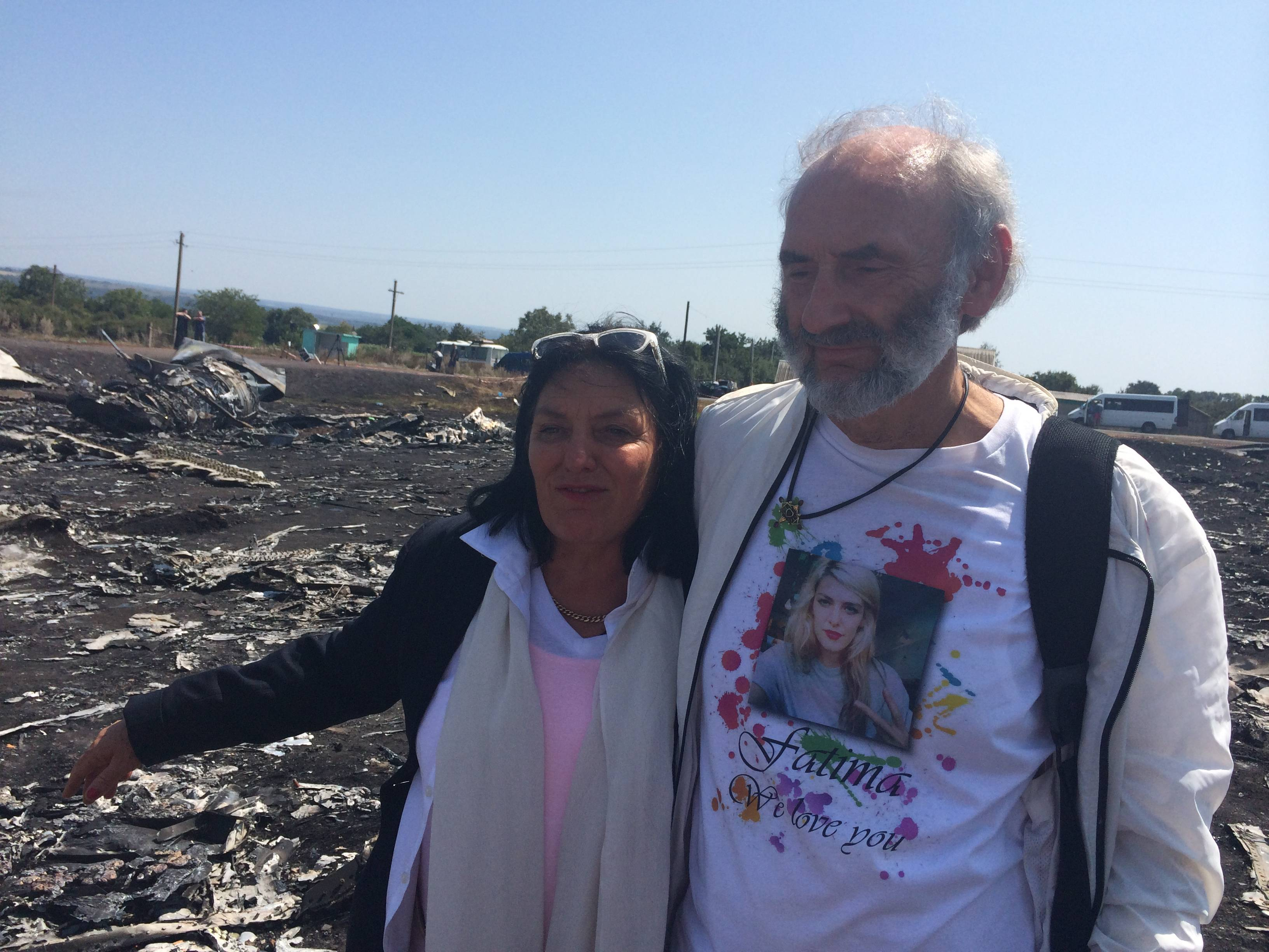 "Jerzy Dyczynski and Angela Rudhart-Dyczynski whose daughter, 25-year-old Fatima, was a passenger on Malaysia Airlines flight MH17, look over the wreckage of the crashed aircraft in Hrabove, Ukraine, Saturday, July 26. The couple who live in Perth, Australia, crossed territory held by pro-Russian rebels to reach the wreckage-strewn farm fields outside the village of Hrabove. They last spoke to Fatima shortly before she boarded the flight for Kuala Lumpur in Amsterdam on July 17. Rudhart-Dyczynski said, ""We have promised our daughter we will come here."""