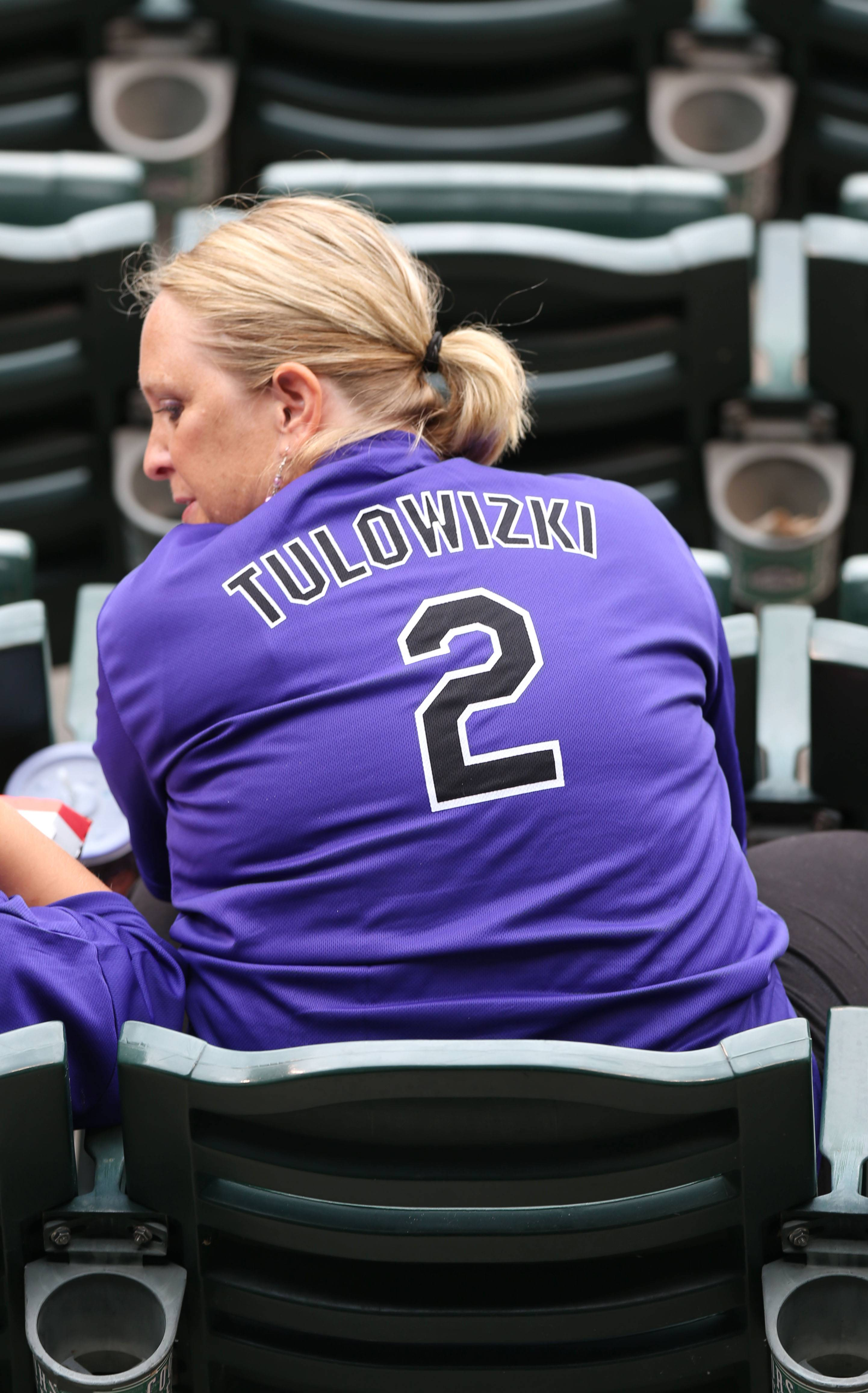 A fan wears one of the misspelled Tulowitzki jerseys given to attendees of Saturday's Pirates-Rockies game in Denver.