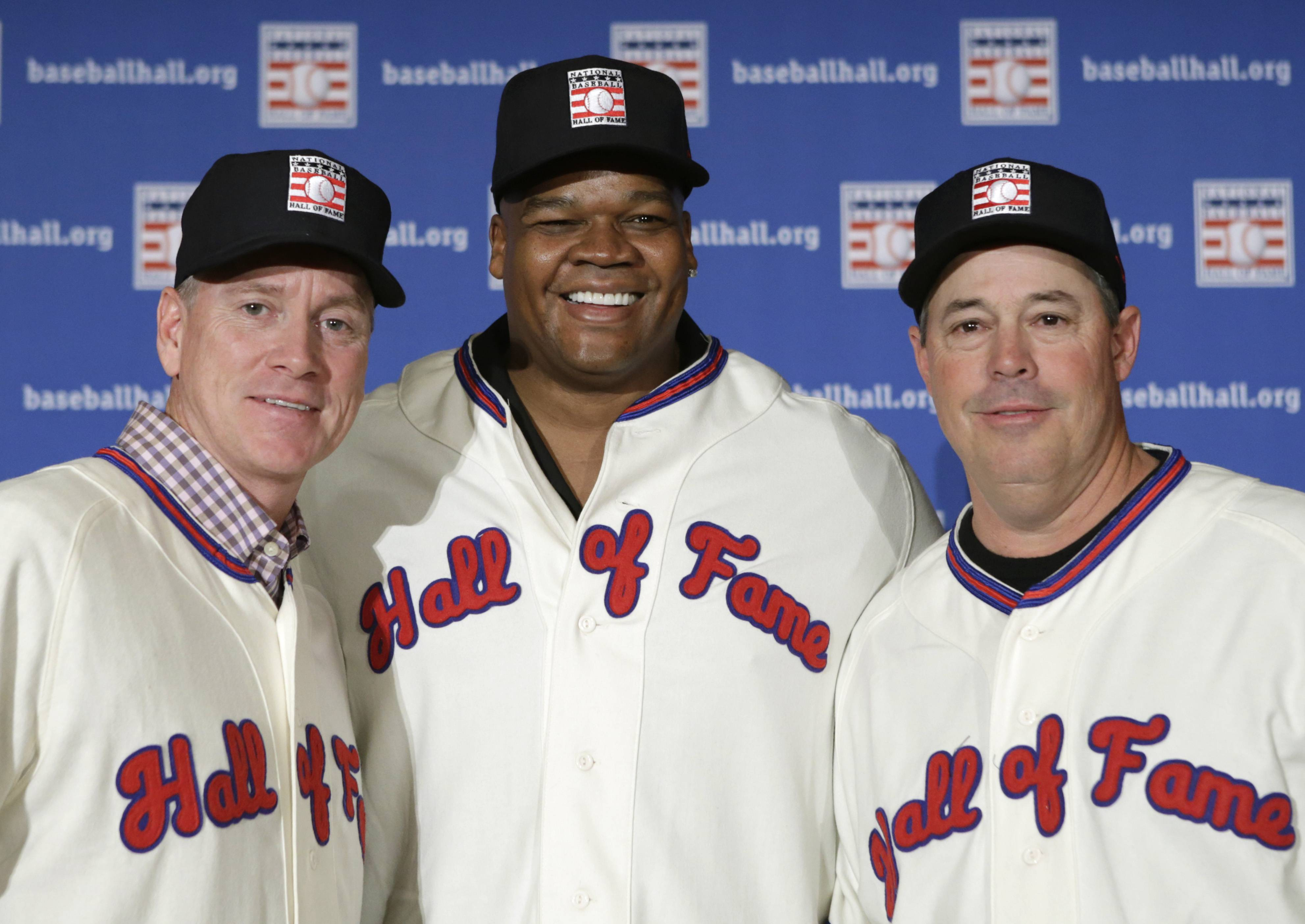 Former Atlanta Braves pitchers Tom Glavine, left, and Greg Maddux, right, pose with Chicago White Sox slugger Frank Thomas after a news conference announcing their election to the 2014 Baseball Hall of Fame class in New York. Induction ceremonies are Sunday in Cooperstown, N.Y.
