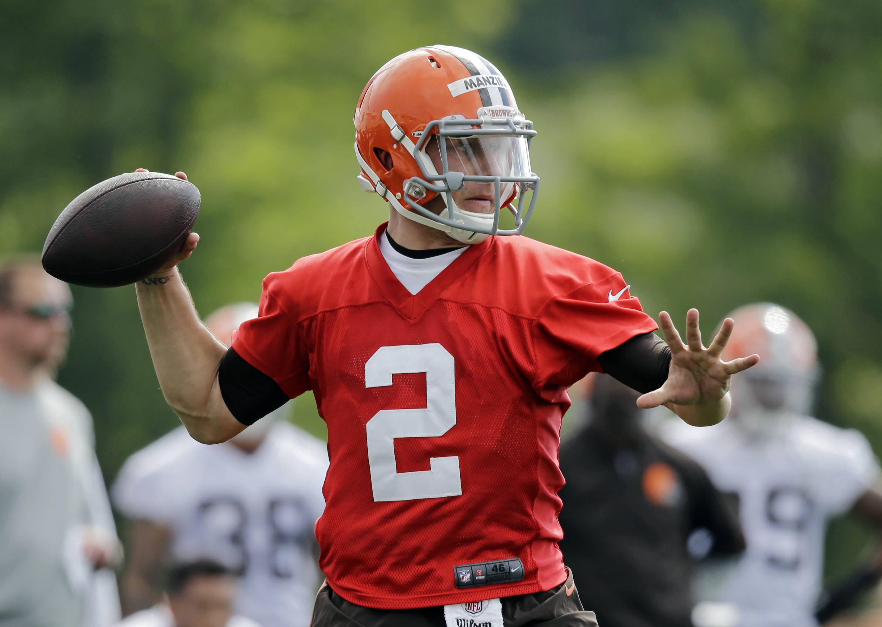 Cleveland Browns quarterback Johnny Manziel (2) passes during the first practice at the NFL football team's training camp in Berea, Ohio Saturday, July 26, 2014.