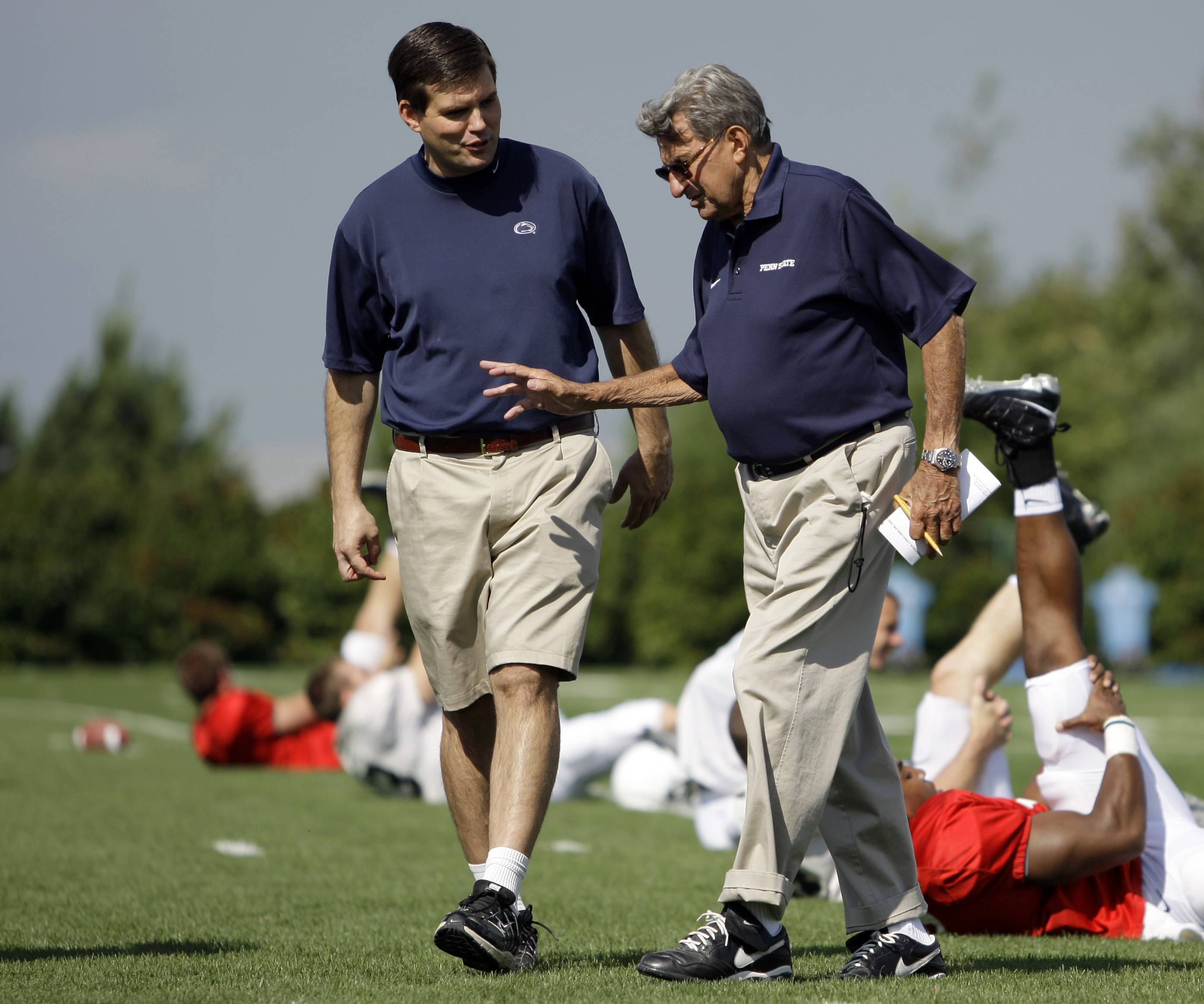 "Former Penn State football coach Joe Paterno, right, is shown here in 2008 walking with his son and quarterback coach Jay Paterno, who has written a new book titled ""Paterno Legacy: Enduring Lessons from the Life and Death of My Father."" Joe Paterno told his son the day after his firing that he hadn't informed the coaching staff about allegations Jerry Sandusky may be a child molester because he was unsure whether they were true, Jay Paterno writes in his new book."