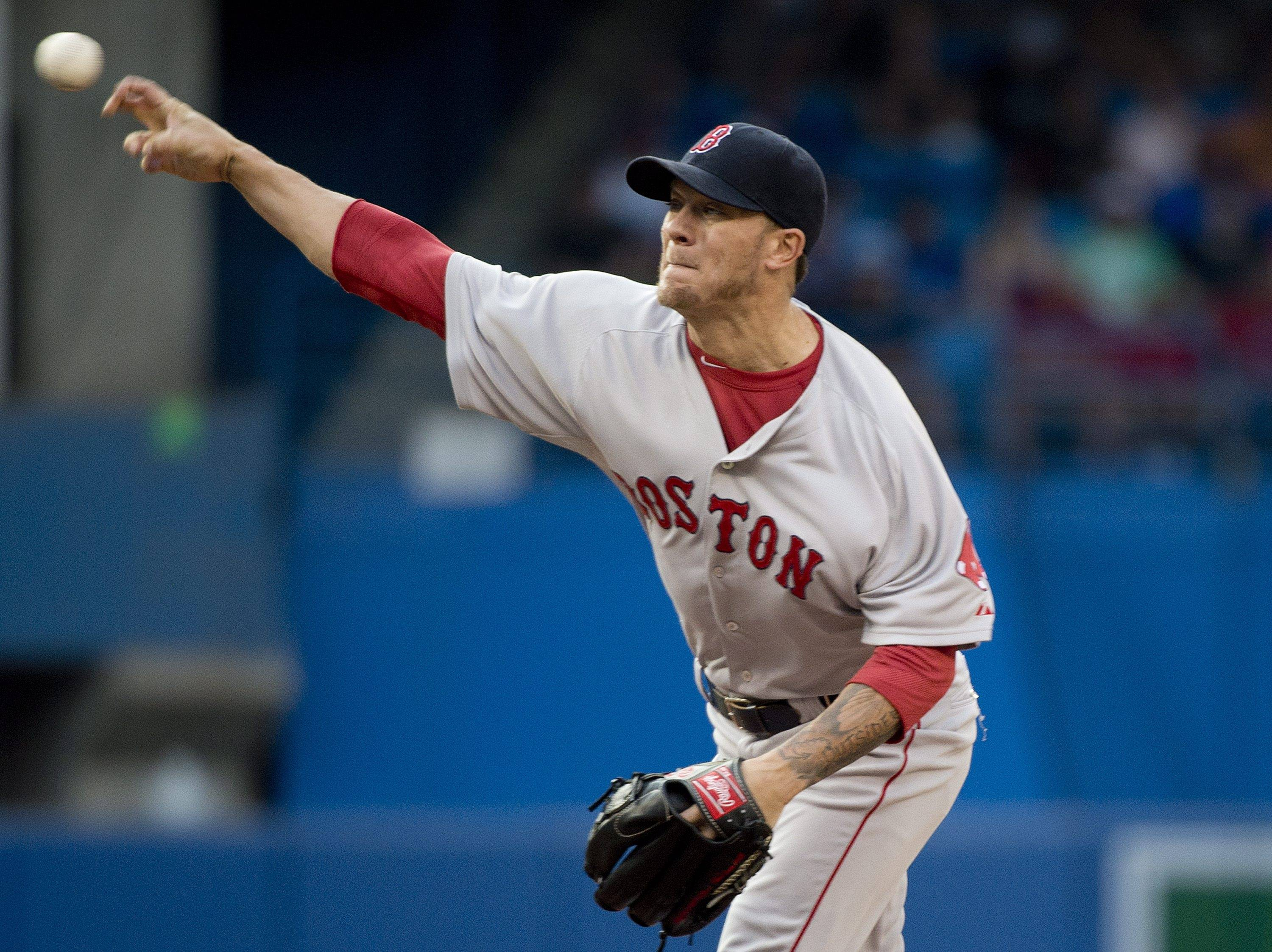 The San Francisco Giants boosted their rotation for the stretch run by acquiring right-hander and former White Sox Jake Peavy from the Boston Red Sox on Saturday for a pair of minor league pitchers.