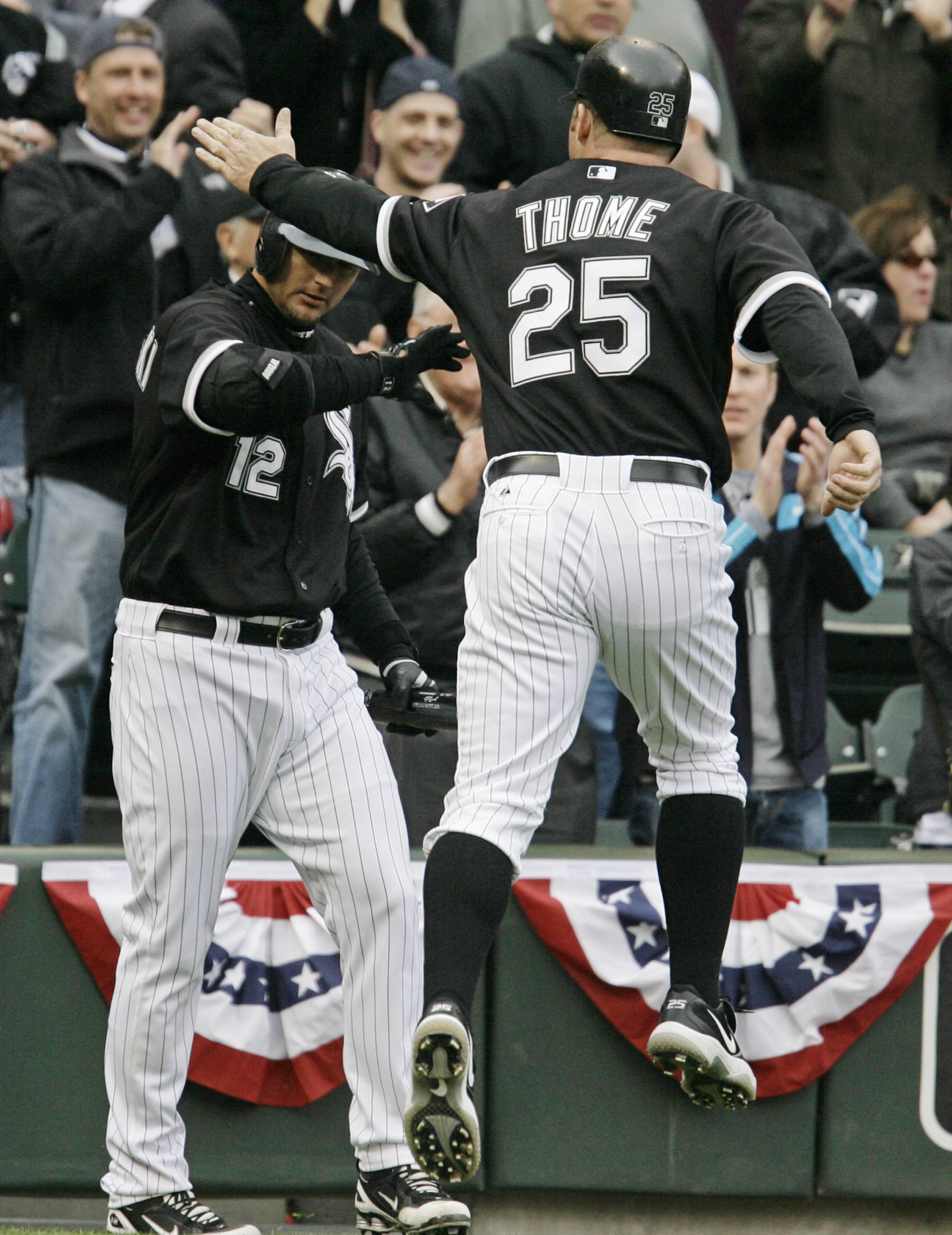Chicago White Soxs' Jim Thome leaps in the air as he celebrates with A.J. Pierzynski after scoring on an RBI single by Jermaine Dye during the seventh inning of an MLB baseball game against the Minnesota Twins' Monday, April 7, 2008 in Chicago. (AP Photo/M. Spencer Green)