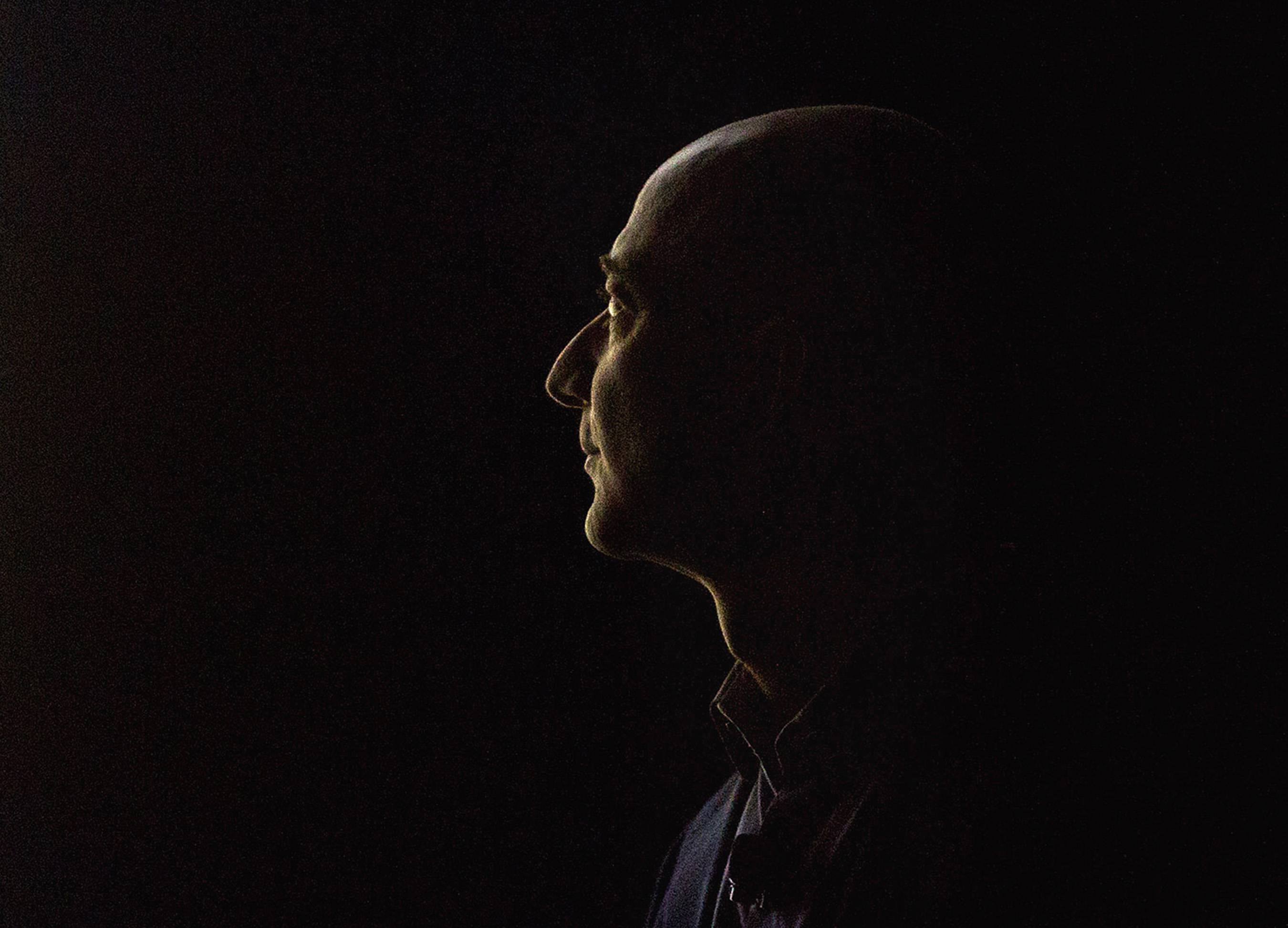 The silhouette of Jeff Bezos, chief executive officer of Amazon.com Inc., as he watches a demonstration of the Fire Phone during an event at Fremont Studios in Seattle, Washington,.