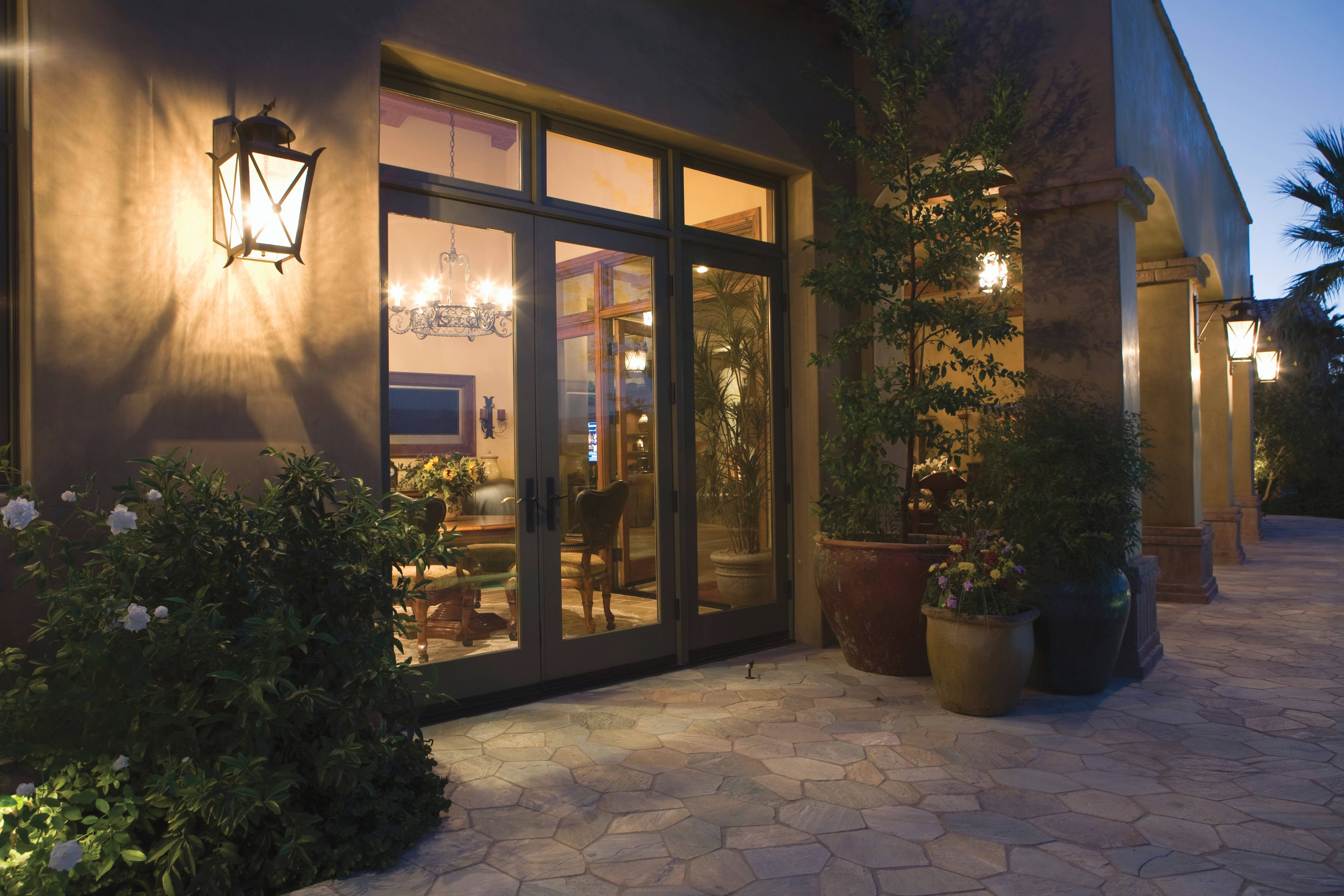Wall-mounted lanterns at a door leading to the patio or outdoor space will provide a warm, welcoming look.