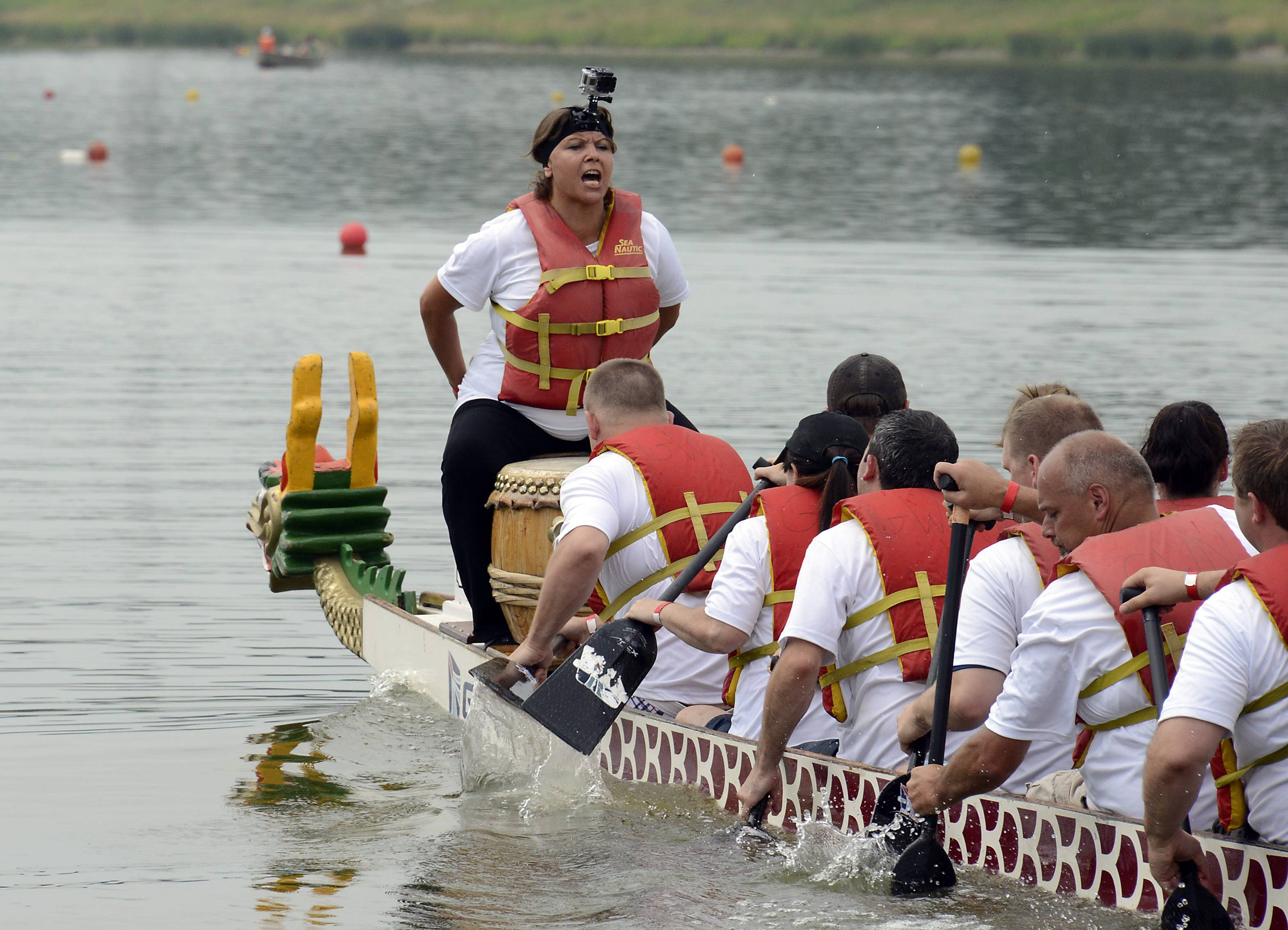 Christine Cartina of Mundelein calls out the beat for the Walgreens Dragon Boat team Pharma-Seas on Saturday at Lake Arlington.