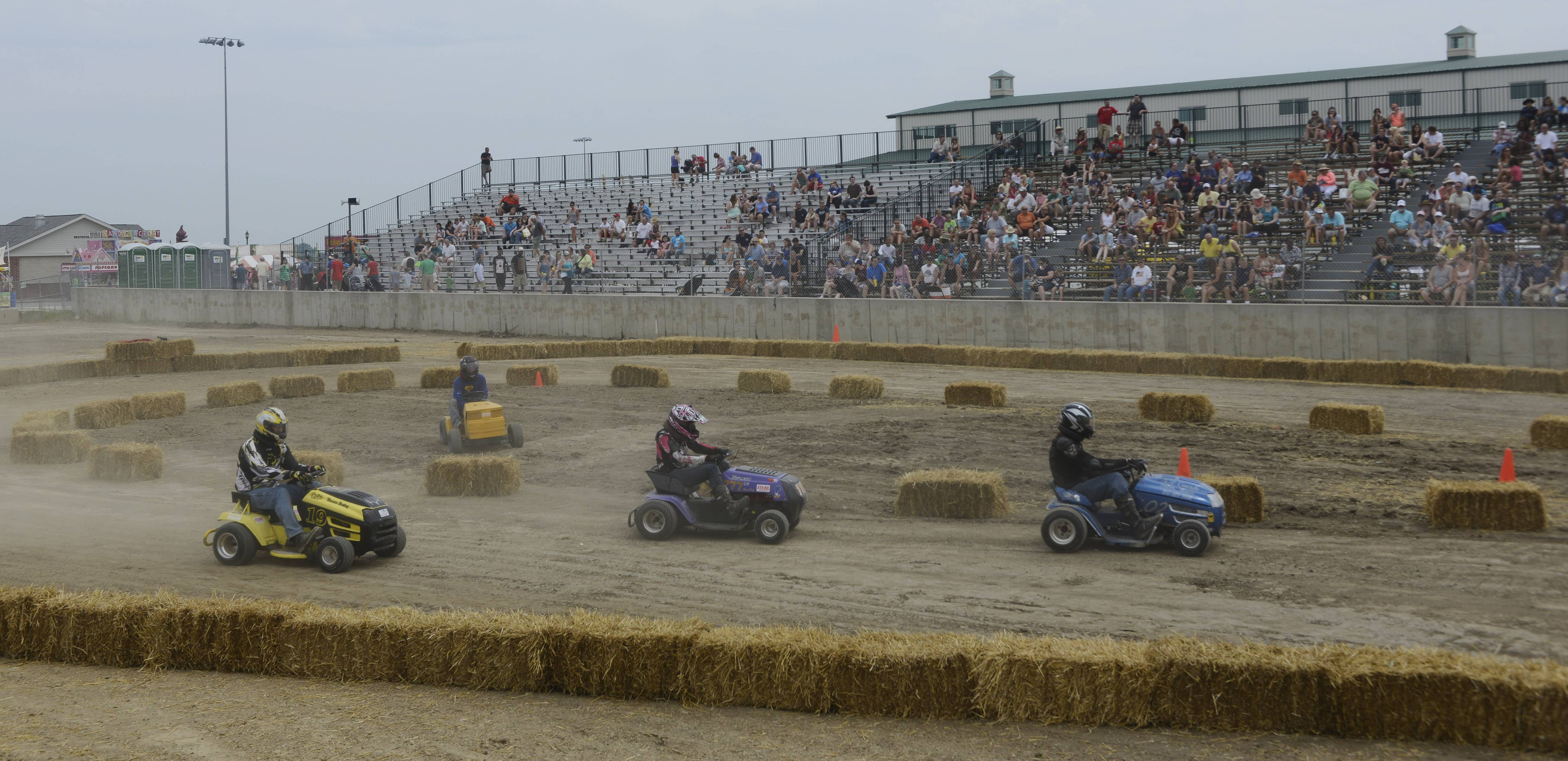 "Participants compete in the ""Mow Down Showdown"" races Saturday at Lake County Fair in Grayslake."