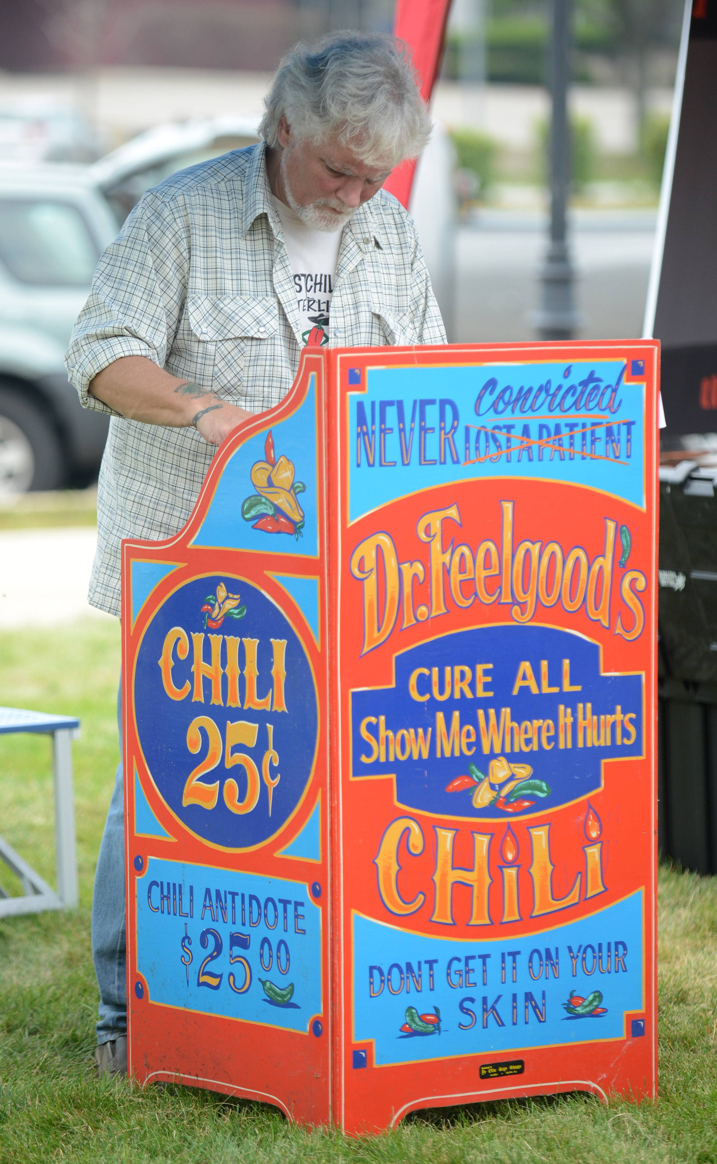 Tim Filgut, of Batavia, stirs his entry in the 22nd annual State Championship Chili Cook-Off along the Batavia Riverwalk Saturday. His Dr. Feelgood Chili won the competition in 1998.