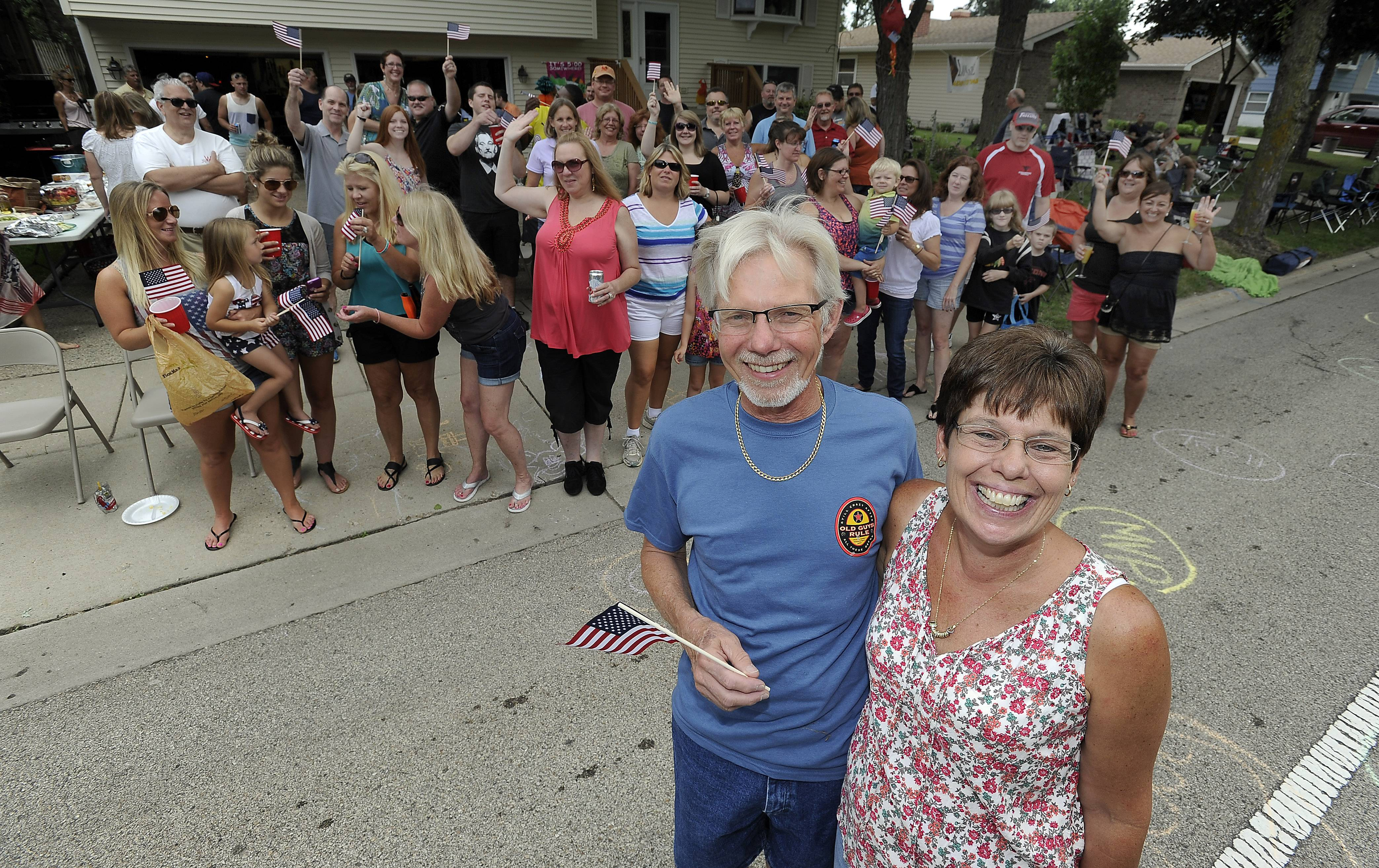 Heinz and Trish Koch and the rest of their group of friends and family party in the Streamwood Summer Celebration parade on Saturday.