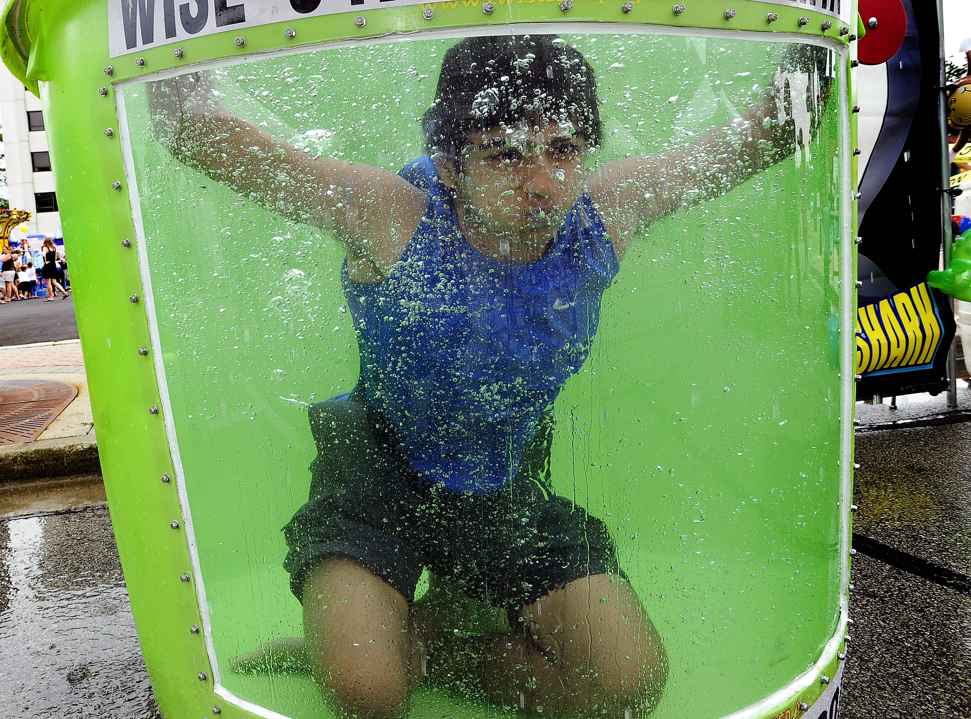 Shivam Patel, 16, of Des Plaines had the best job on a hot summer day, manning the dunk tank Saturday at the 15th annual Mount Prospect Downtown Block Party. He took a break after a series of kids with major-league arms continued to make his life more on the wet side than dry side.