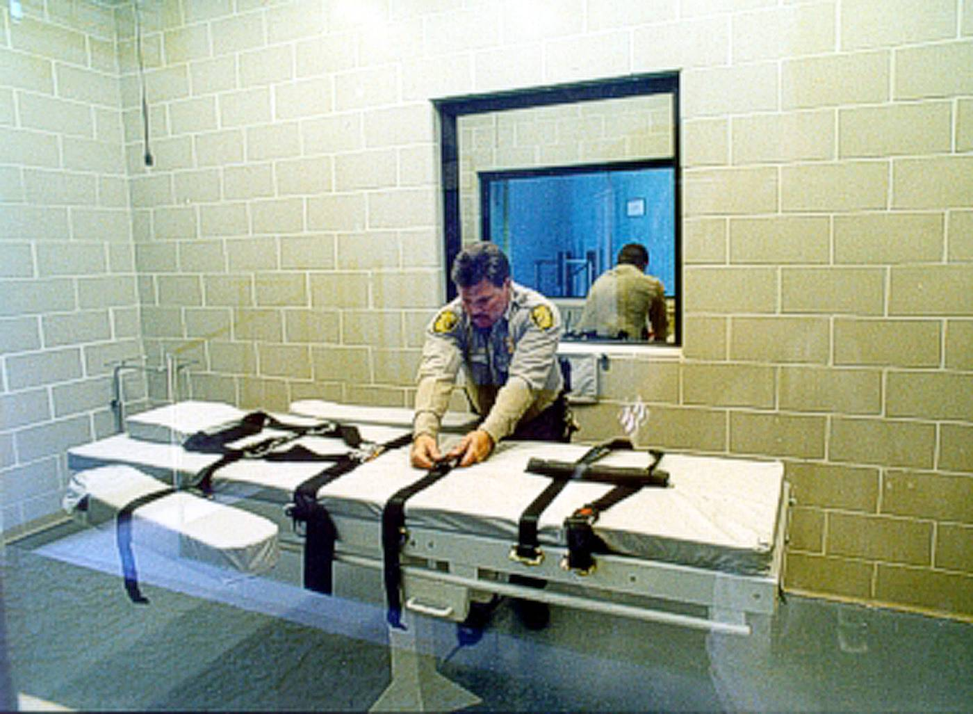 In this undated file photo provided by the Arizona Department of Corrections, an unidentified Arizona Corrections Officer adjusts the straps on the gurney used for lethal injections at the Arizona State Prison at Florence, Ariz. The prolonged execution this week of an Arizona death row inmate with a new, two-drug combination highlights the patchwork approach states have been forced to take with lethal injection drugs, with the types, combinations and dosages varying widely.