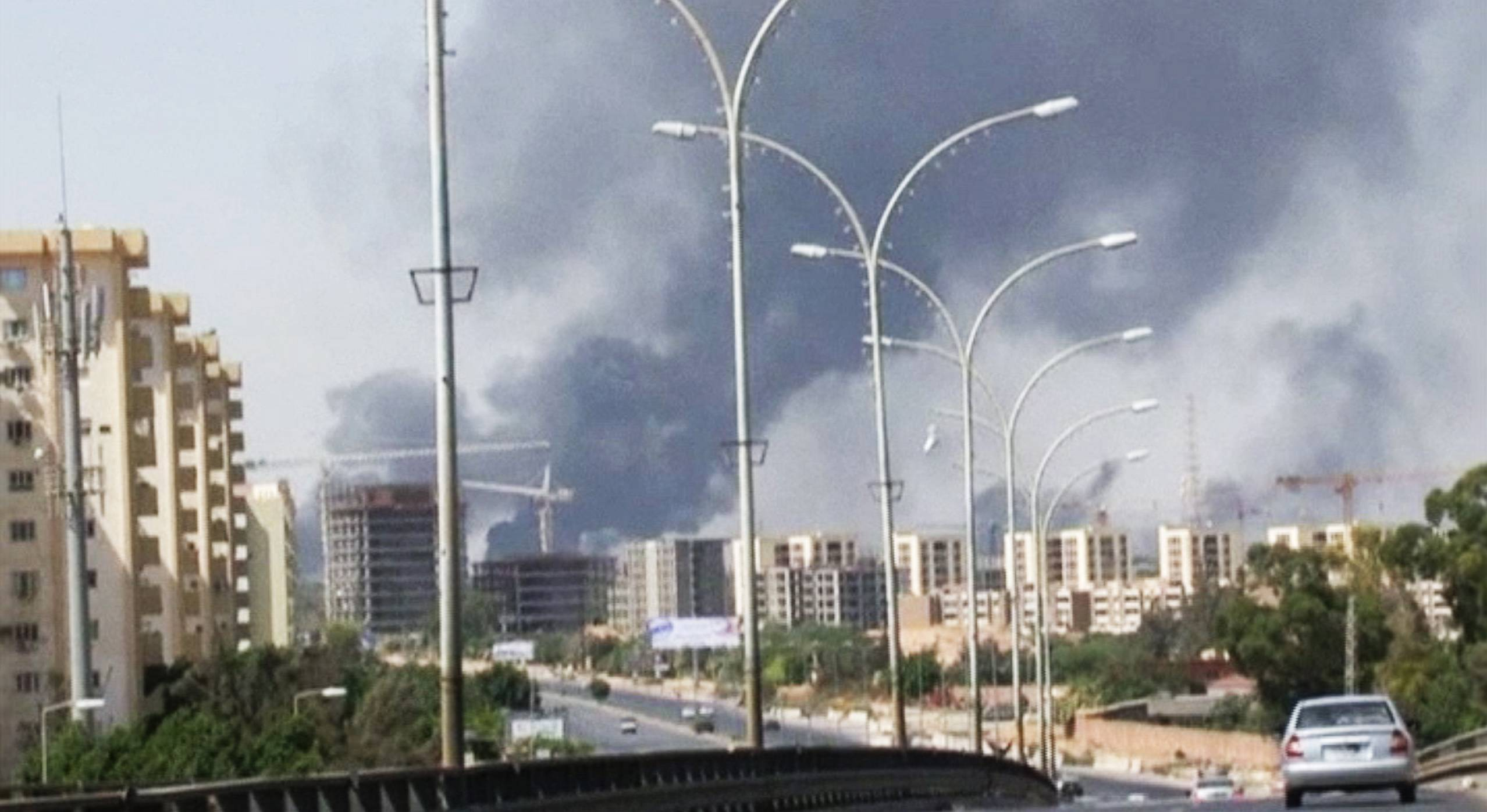 In this Sunday, July 13, 2014 file image made from video by The Associated Press, smoke rises from the direction of Tripoli airport in Tripoli, Libya. The United States shut down its embassy in Libya on Saturday and evacuated its diplomats to neighboring Tunisia under U.S. military escort amid a significant deterioration in security in Tripoli as fighting intensified between rival militias, the State Department said.
