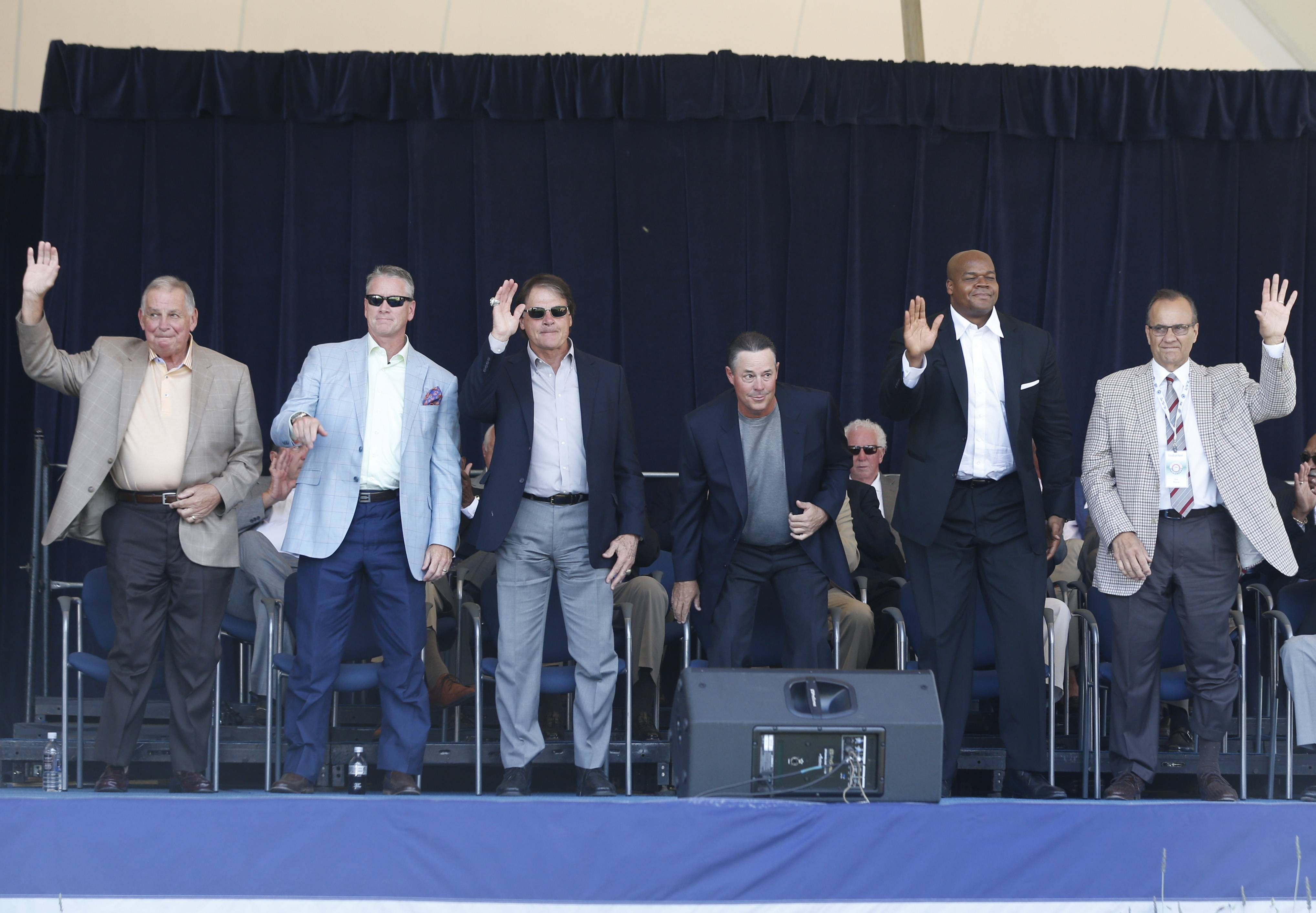 Baseball Hall of Fame electees Bobby Cox, Tom Glavine, Tony La Russa, Greg Maddux, Frank Thomas and Joe Torre are introduced during an awards ceremony at Doubleday Field on Saturday, July 26, 2014, in Cooperstown, N.Y. They will be inducted on Sunday.