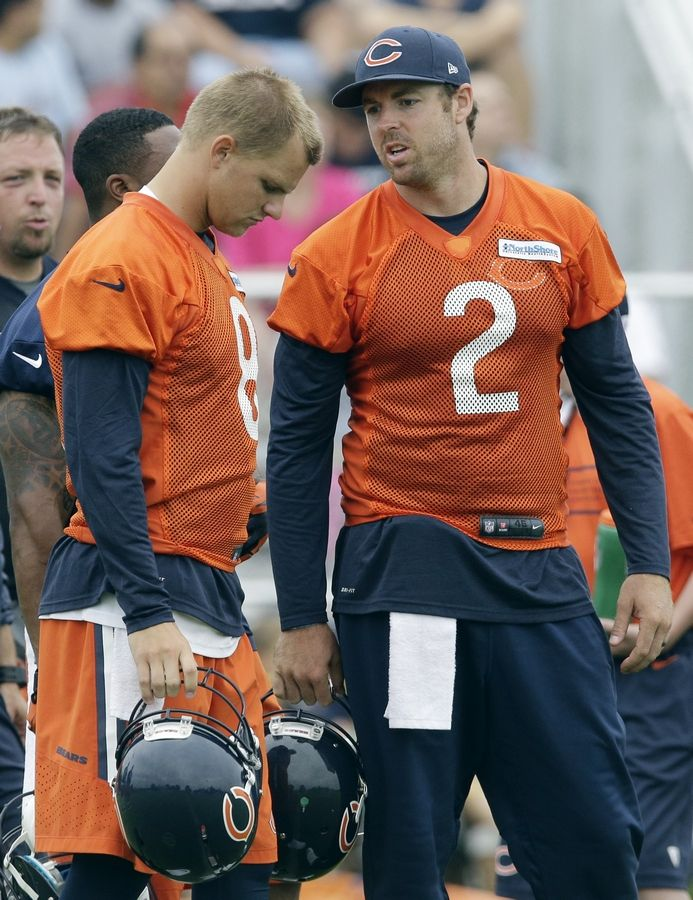 Jordan Palmer, right, talks to fellow quarterback Jimmy Clausen during Bears training camp Saturday at Olivet Nazarene University in Bourbonnais, Ill.