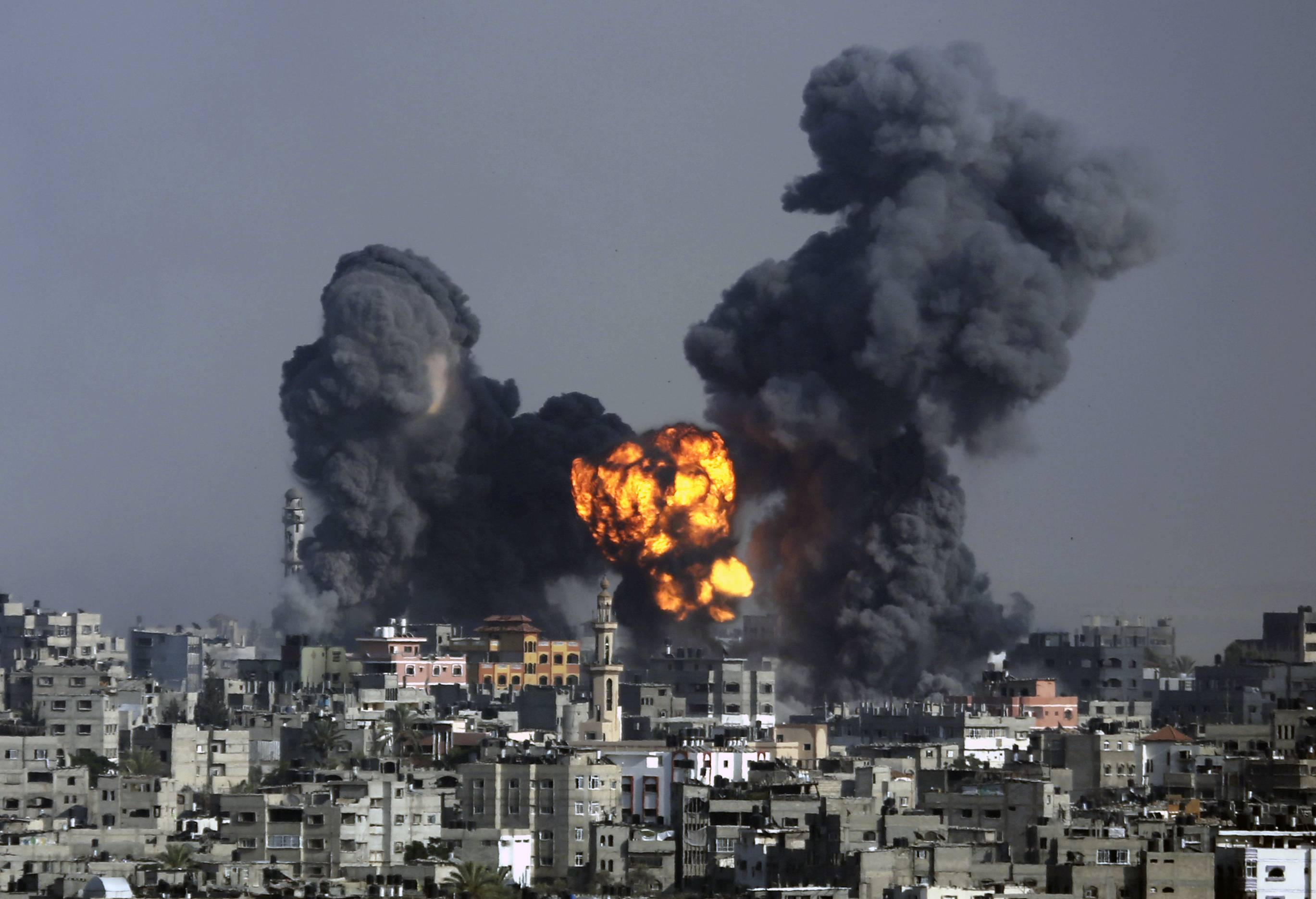 Smoke and fire from the explosion of an Israeli strike rise over Gaza City, Tuesday, July 22, 2014, as Israeli airstrikes pummeled a wide range of locations along the coastal area and diplomatic efforts intensified to end the two-week war.
